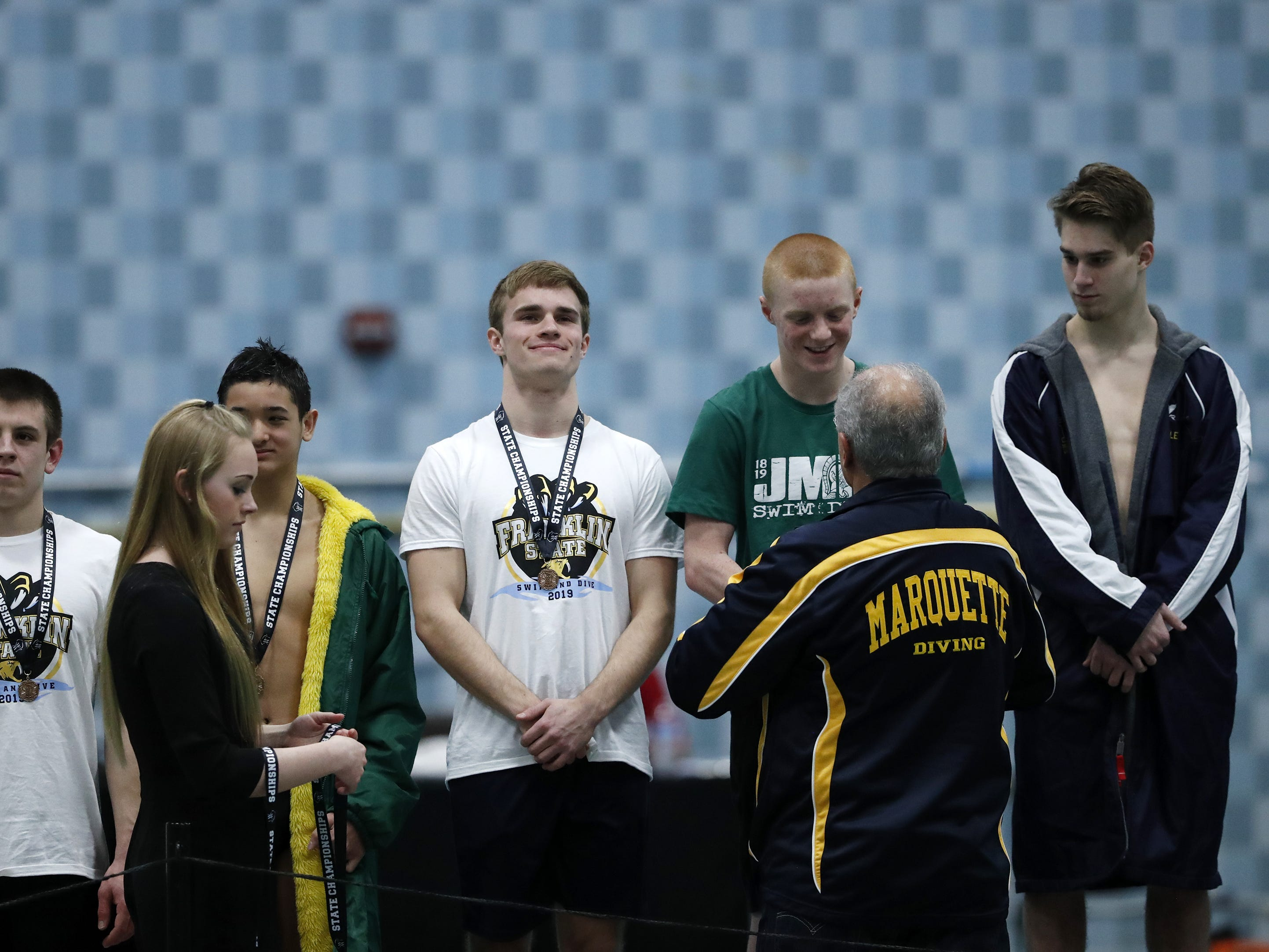 Franklin's Jared Kleczka (center) stands after receiving 4th place during the Division 1 2019 State Boys Swimming and Diving Championships Saturday, Feb. 16, 2019, at the UW Natatorium in Madison, Wis. Danny Damiani/USA TODAY NETWORK-Wisconsin