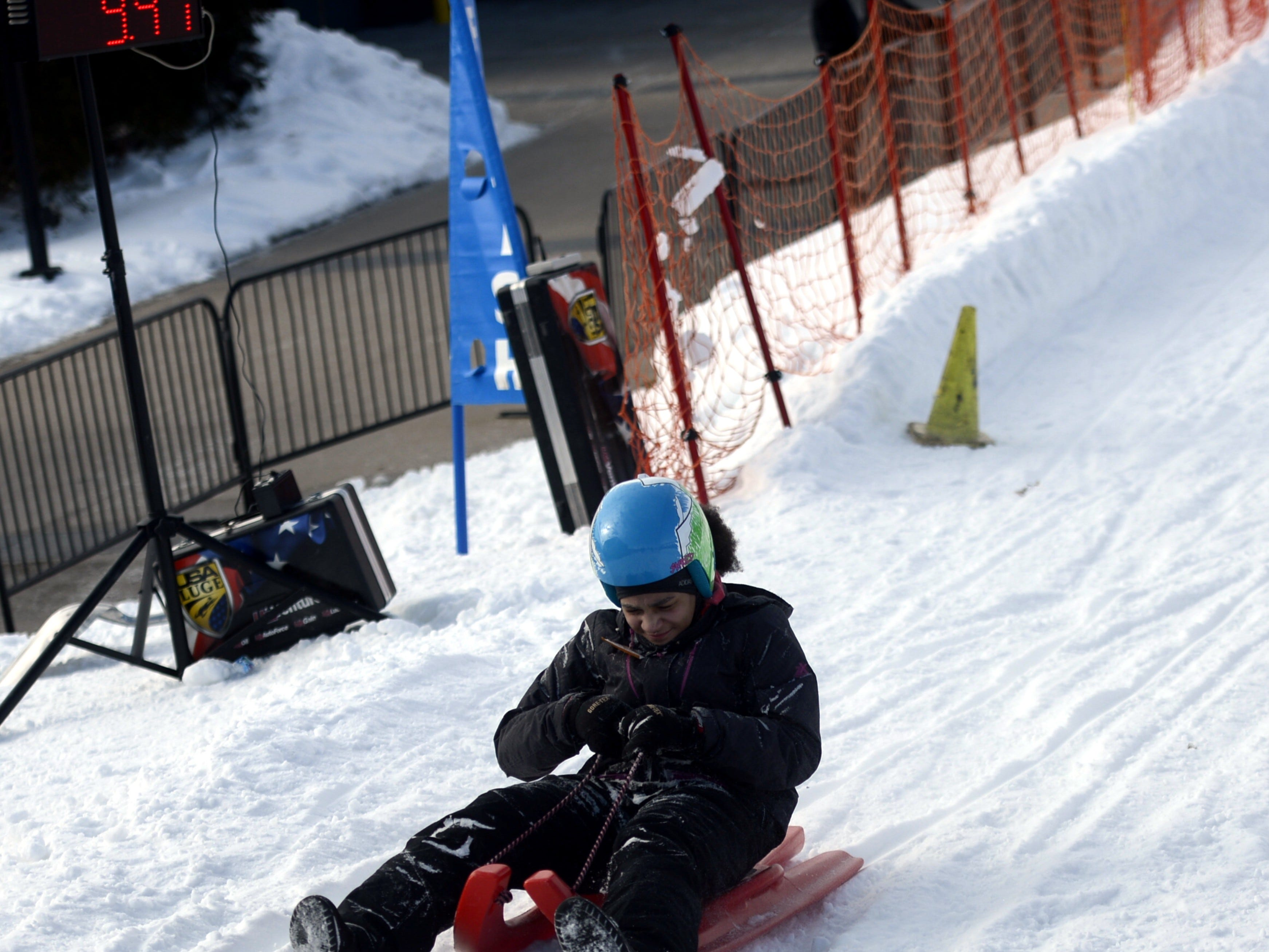 A rider tries the luge course on Airiens Hill in Titletown District during the Titletown Winter Games on Saturday, Feb. 16, 2019.