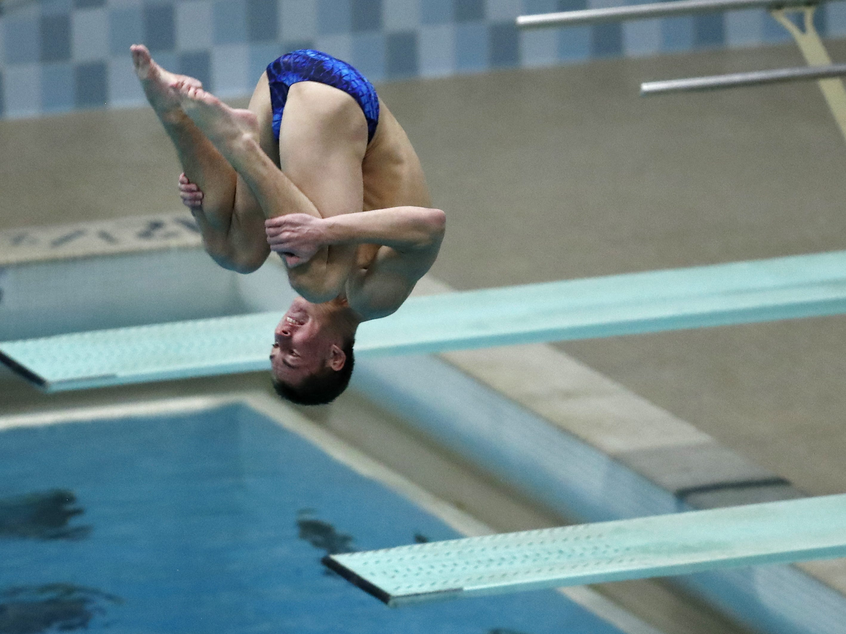 Brookfield Central/East's Braden Rumpit dives during the during the Division 1 2019 State Boys Swimming and Diving Championships Saturday, Feb. 16, 2019, at the UW Natatorium in Madison, Wis. Danny Damiani/USA TODAY NETWORK-Wisconsin