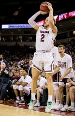 South Carolina guard Hassani Gravett (2) makes a 3-pointer against Texas A&M Saturday afternoon at the Colonial Life Arena in Columbia.