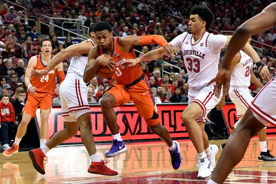 Clemson guard Clyde Trapp (0) drives to the basket against Louisville forward Jordan Nwora (33) during the first half at KFC Yum! Center Saturday afternoon in Louisville, Ky.TODAY Sports