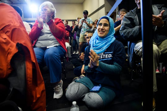 Laila Jaber applauds as she and more than two hundred others listen to U.S. Sen. Elizabeth Warren speak during a campaign event at the West End Community Development Center in Greenville Saturday, Feb. 16, 2019.