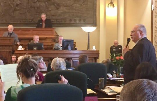 Sen. Frank Smith, D-Poplar, right, talks Saturday on the Senate floor about SB 40.