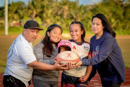 Mara Tamayo, third from left, is joined by family at her rugby game at Okkodo High School.  From left, Marlon Tamayo, her father, Ayva Tamayo, sister, and Stephanie Tamayo, her mother.