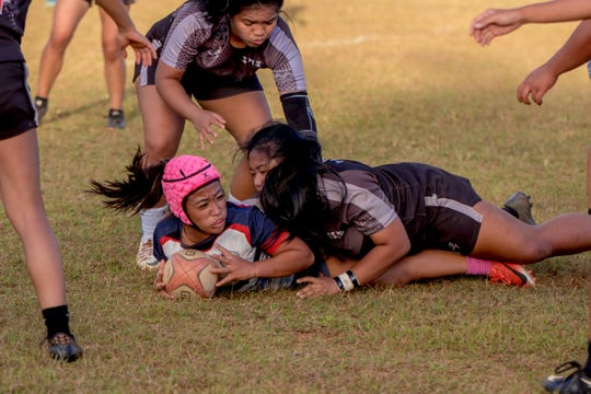 Mara Tamayo of Okkodo High School in action during a rubgy game against Simon Sanchez High School on Feb. 14.