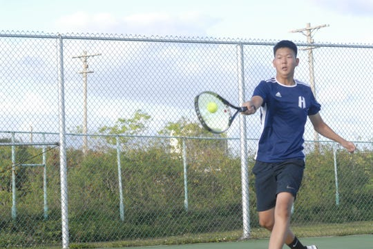 Harvest Christian Academy's Daniel Lee hits a forehand against FD during their IIAAG Boys Tennis match Friday at the University of Guam tennis courts.