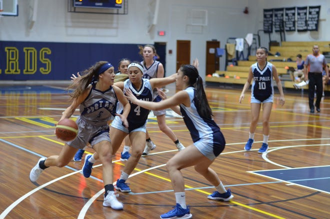 The Warriors' Tiffani Lopez, No. 4, and Jannaliese Quintanilla play defense against an opponent from the Morrison Academy Mustangs. The Warriors beat the Mustangs 53-41 at the 2019 Asian Christian Schools' Conference Girls' Basketball Tournament in Manila.