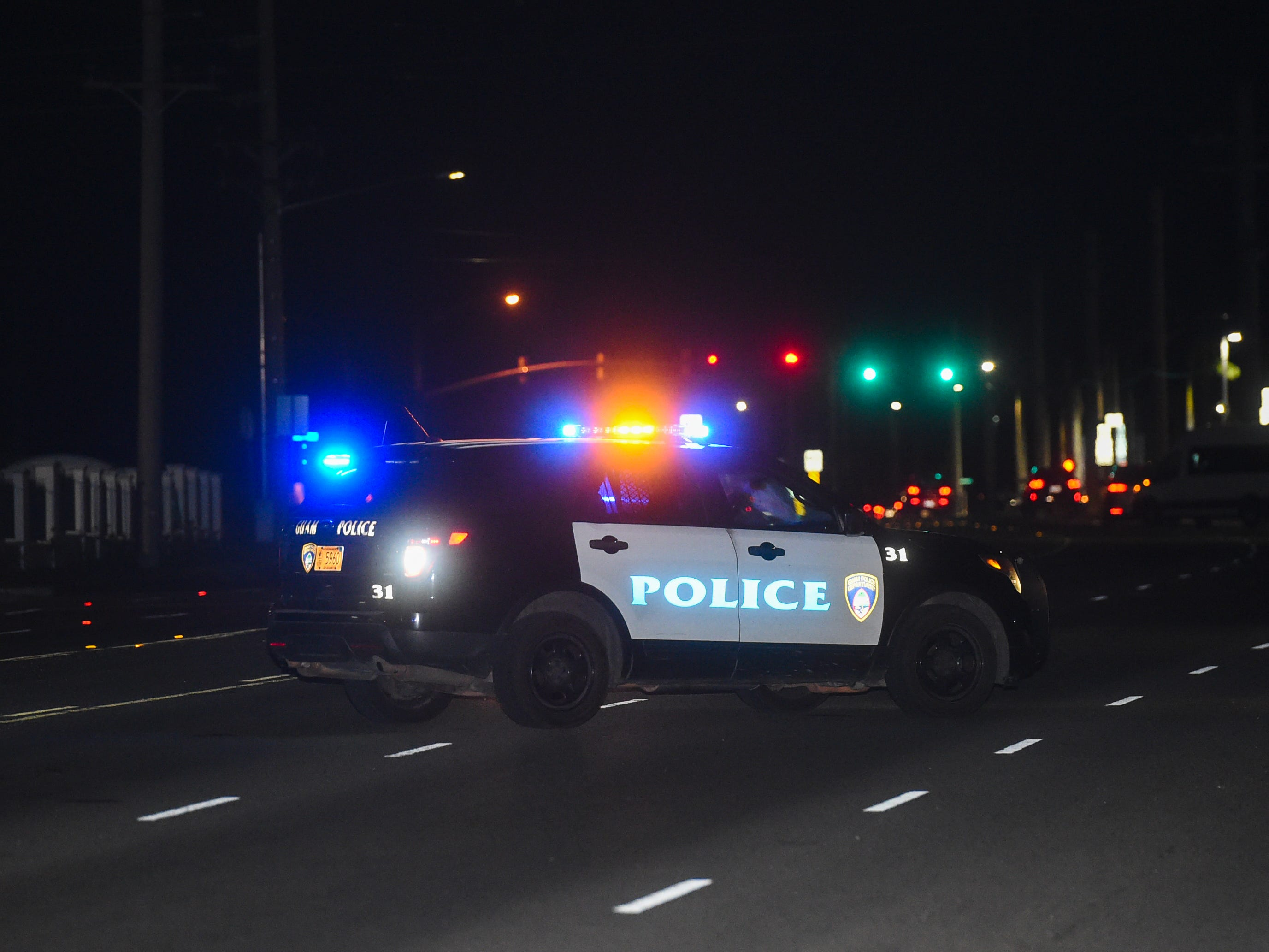 Guam Police Department units at the scene of an auto-pedestrian crash on Route 8 in Maite, Feb. 17, 2019.