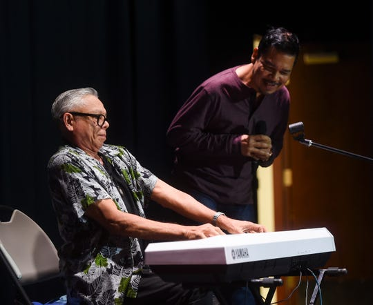Former The Kasuals bandmates Patrick Palomo, left, and Jesse Bias perform during a HITA Talk at the Guam Museum on Feb. 16, 2019.