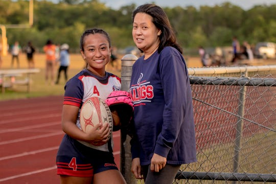 Mara Tamayo and her mother Stephanie Tamayo gather after a rugby game at Okkodo High School on Feb. 14.