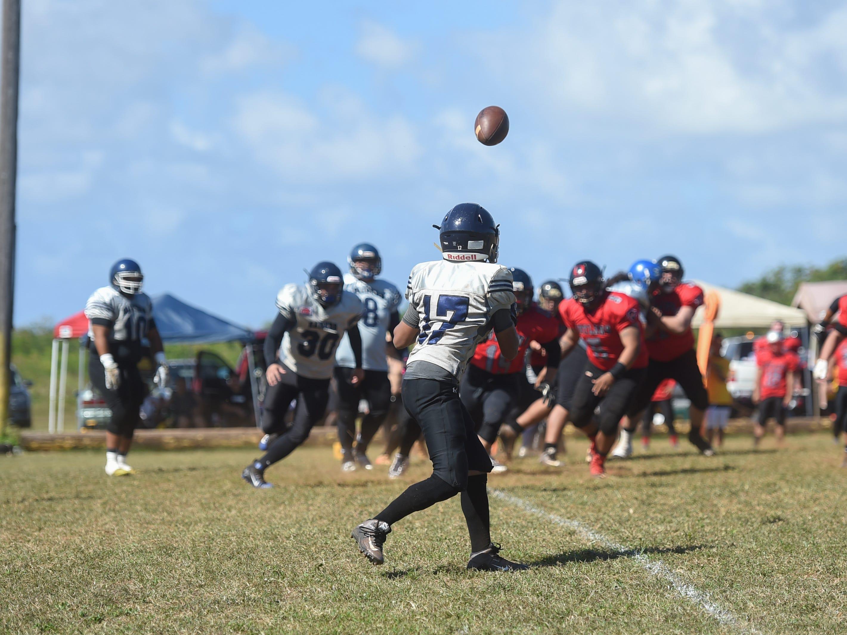 Guam Raiders player Spade Untalan (17) anticipates a pass against the Outlaws during their Budweiser Guahan Varsity Football League game at Eagles Field in Mangilao, Feb. 16, 2019.