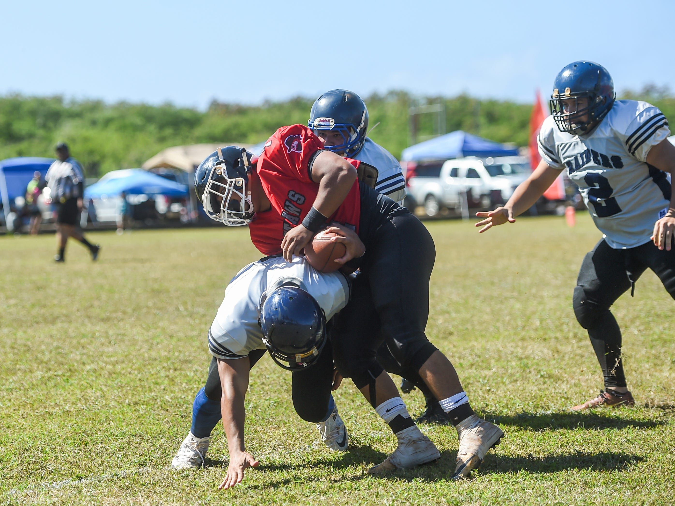 The Guam Raiders took on the Outlaws in Budweiser Guahan Varsity Football League action at Eagles Field in Mangilao, Feb. 16, 2019.