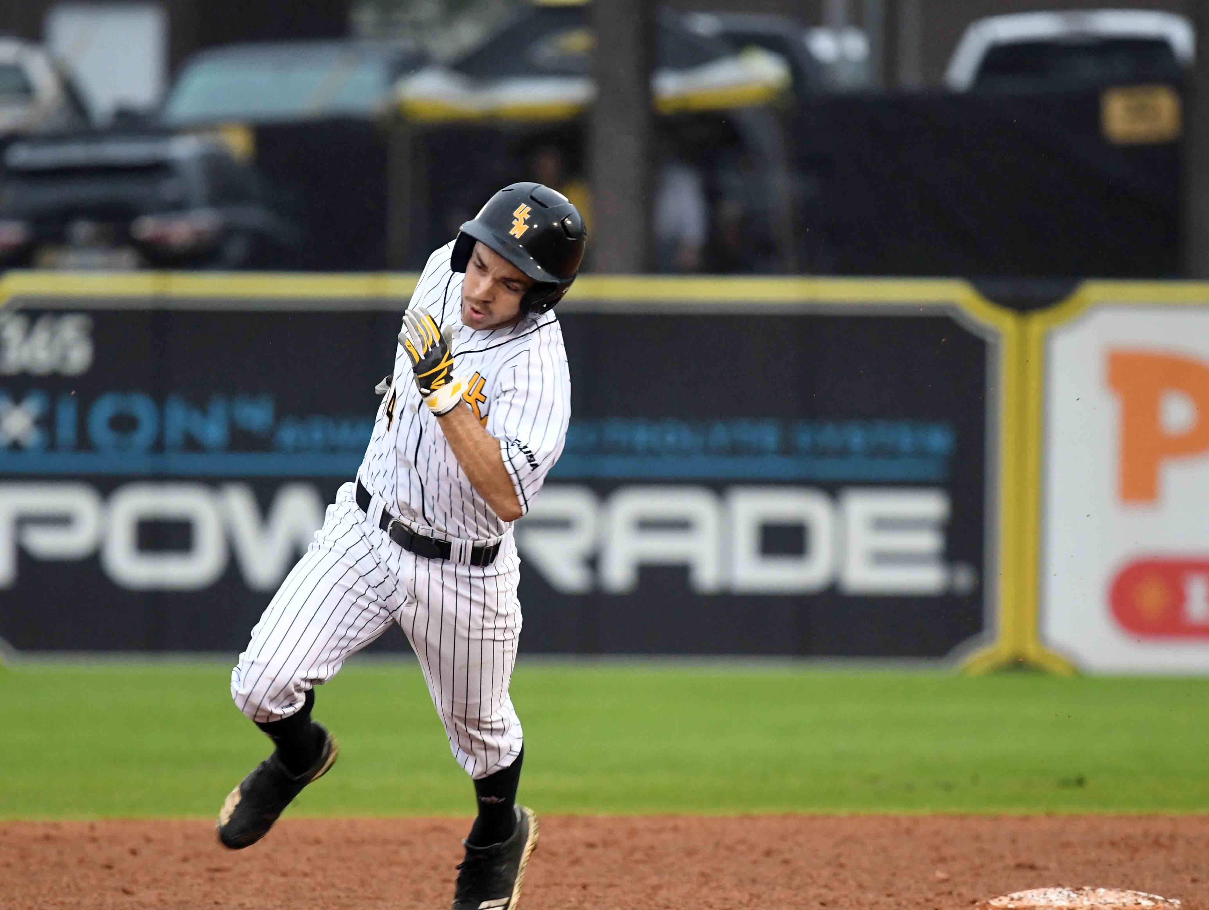 Southern Miss' Gabe Montenegro sprints to third base in the season opener against Purdue on Friday, February 15, 2019.