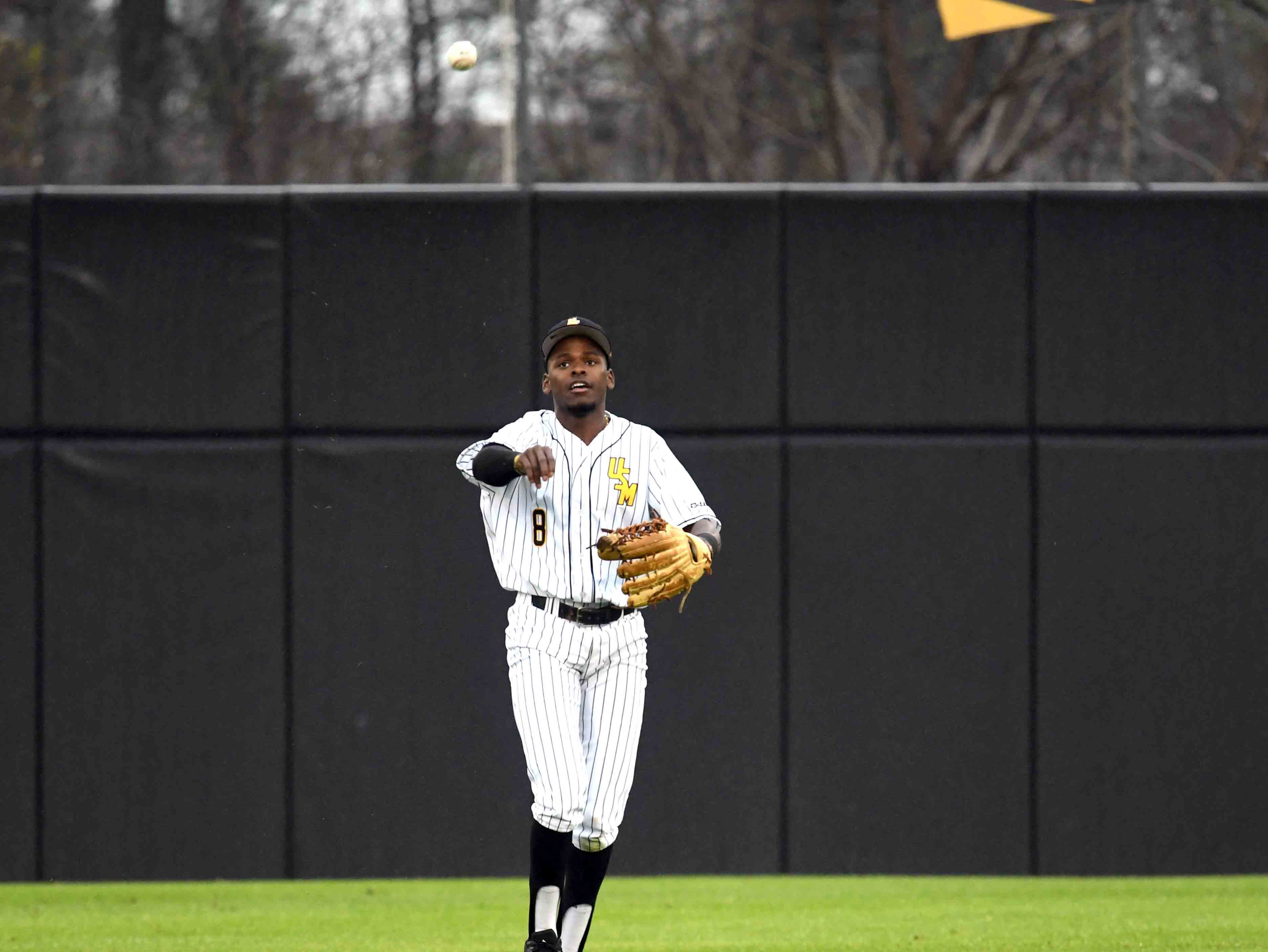 Southern Miss outfielder Fred Franklin throws back the ball  in the season opener against Purdue on Friday, February 15, 2019.