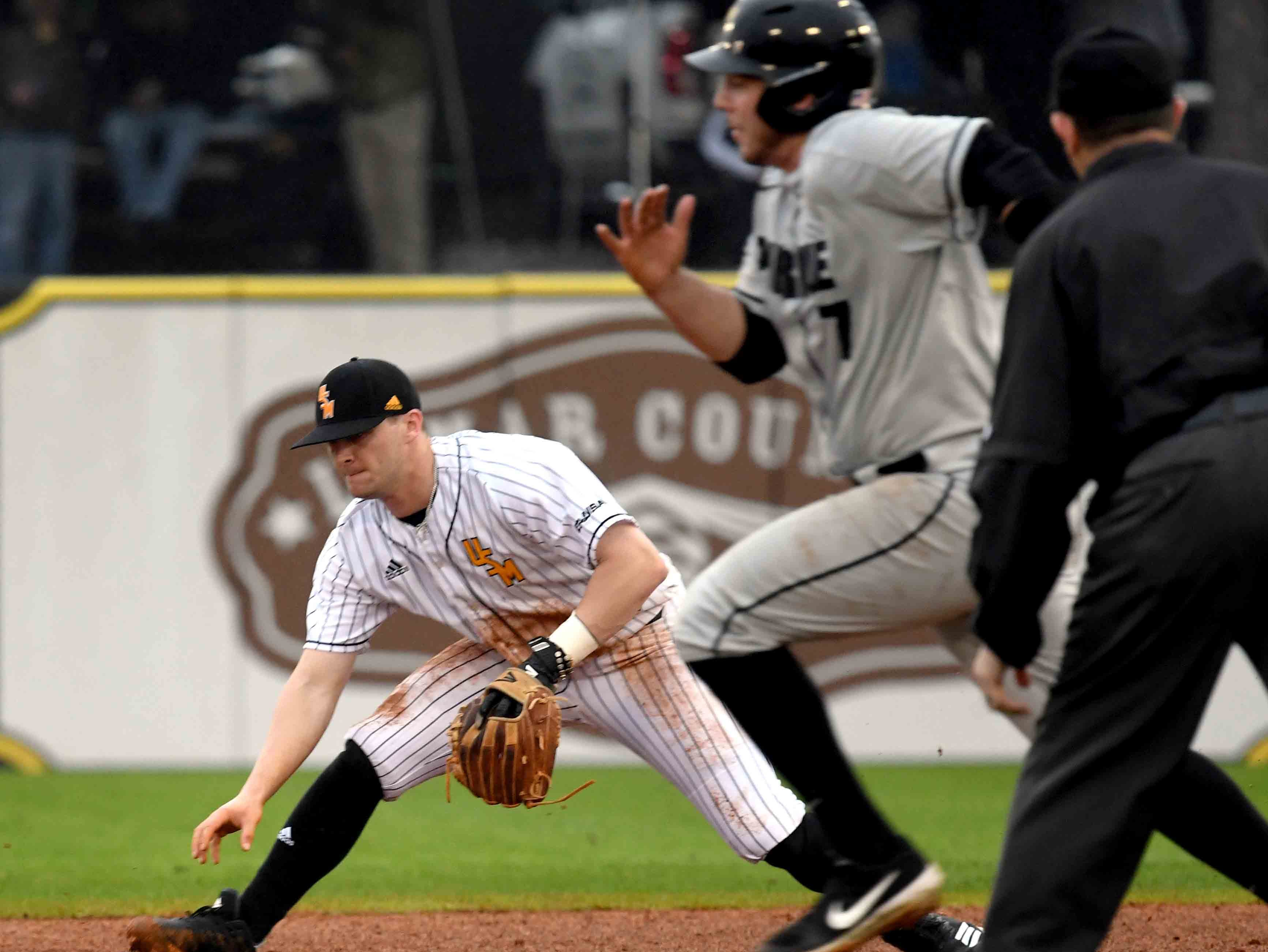 Southern Miss' Matthew Guidry reaches for the ball in the season opener against Purdue on Friday, February 15, 2019.