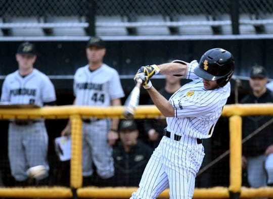 Southern Miss' Gabe Montenegro swings for the ball in the season opener against Purdue on Friday, February 15, 2019.