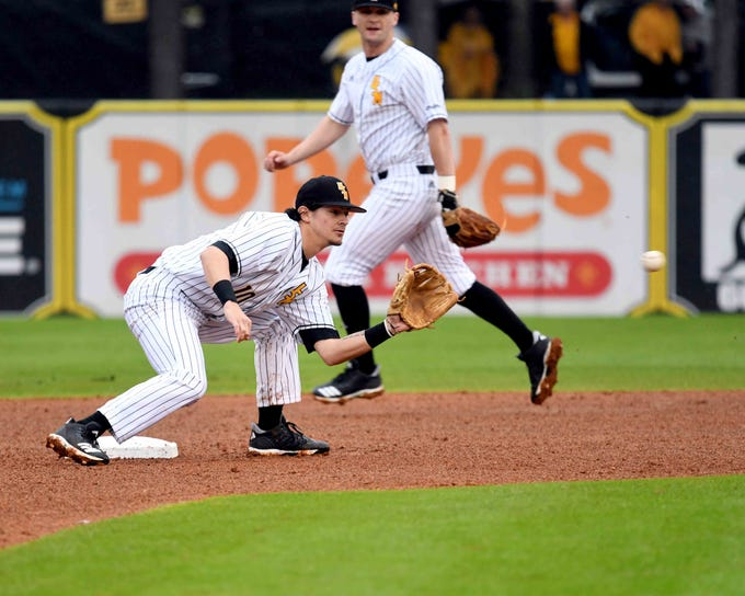 Southern Miss infielder Storme Cooper catches the ball in the season opener against Purdue on Friday, February 15, 2019.
