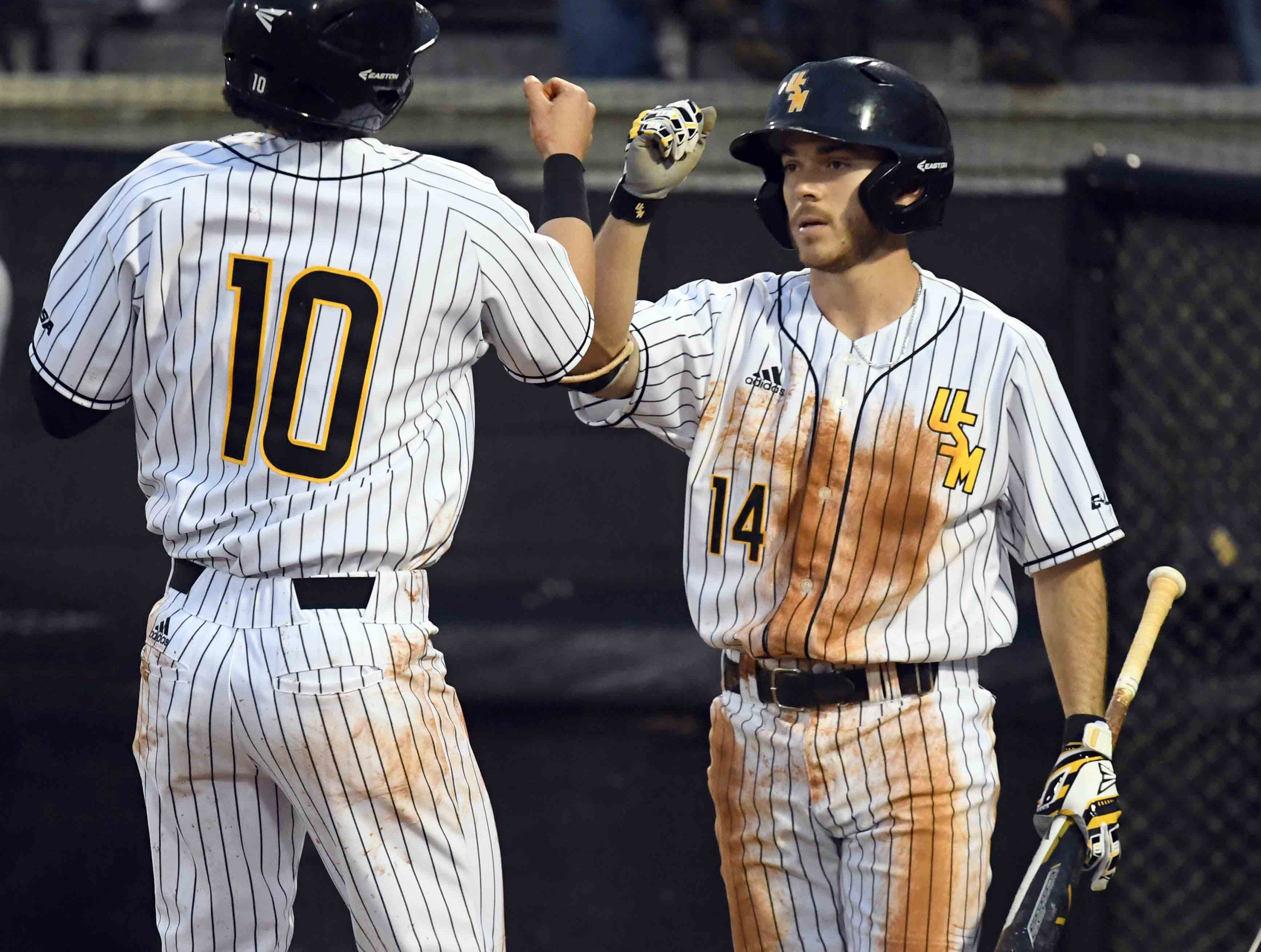 Southern Miss' Gabe Montenegro and Storme Cooper celebrates after a run in the season opener against Purdue on Friday, February 15, 2019.