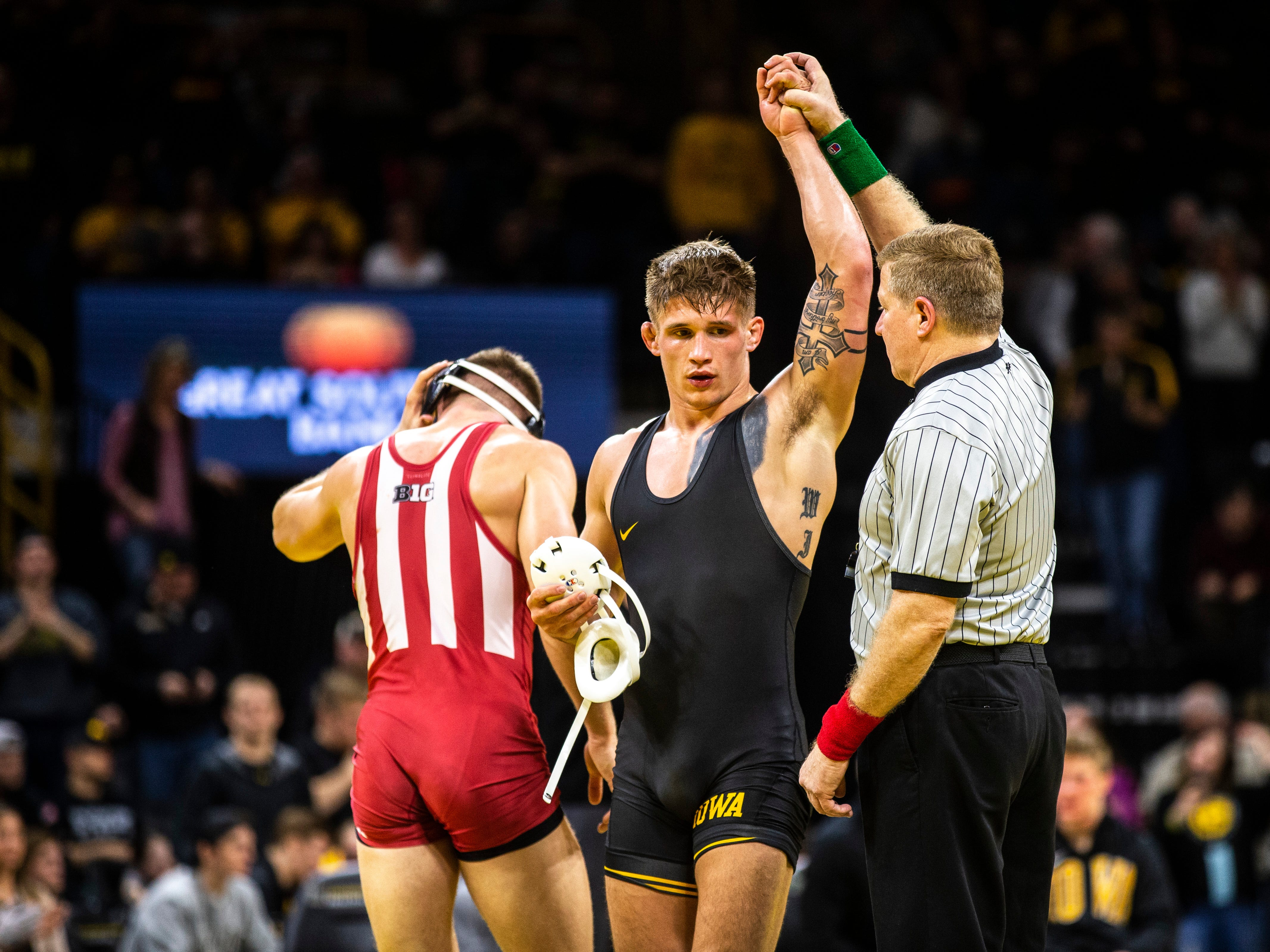 Iowa's Cash Wilcke has his hand raised after scoring a decision over Indiana's Norman Conley at 184 during a NCAA Big Ten Conference wrestling dual on Friday, Feb. 15, 2019 at Carver-Hawkeye Arena in Iowa City, Iowa.