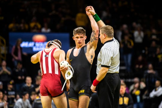 Iowa's Cash Wilcke has his hand raised after scoring a decision over Indiana's Norman Conley at 184 during a NCAA Big Ten Conference wrestling dual on Friday, Feb. 15, 2019, at Carver-Hawkeye Arena in Iowa City, Iowa.