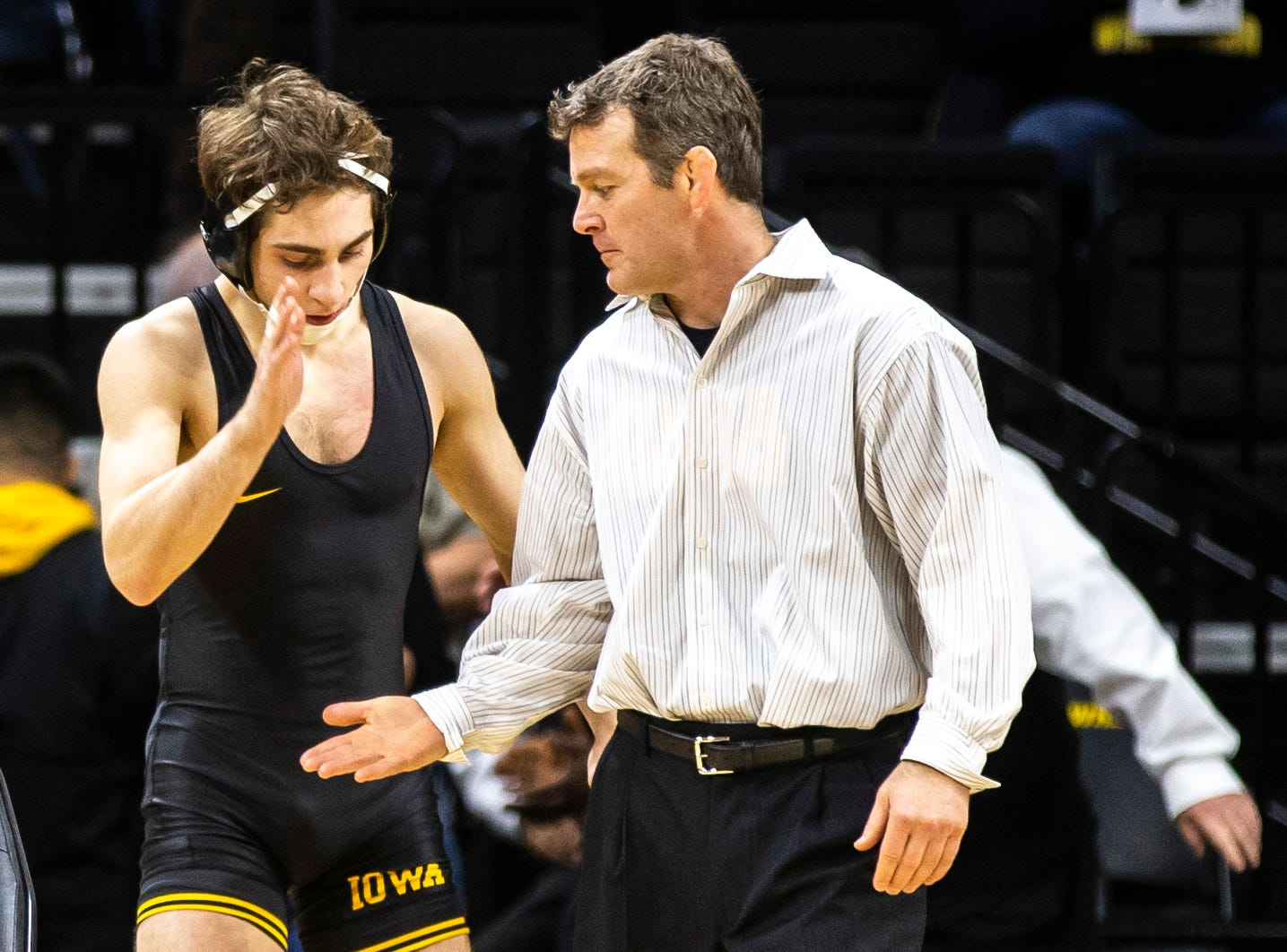 Iowa's Austin DeSanto gives head coach Tom Brands a high-five before his match at 133 a NCAA Big Ten Conference wrestling dual on Friday, Feb. 15, 2019 at Carver-Hawkeye Arena in Iowa City, Iowa.