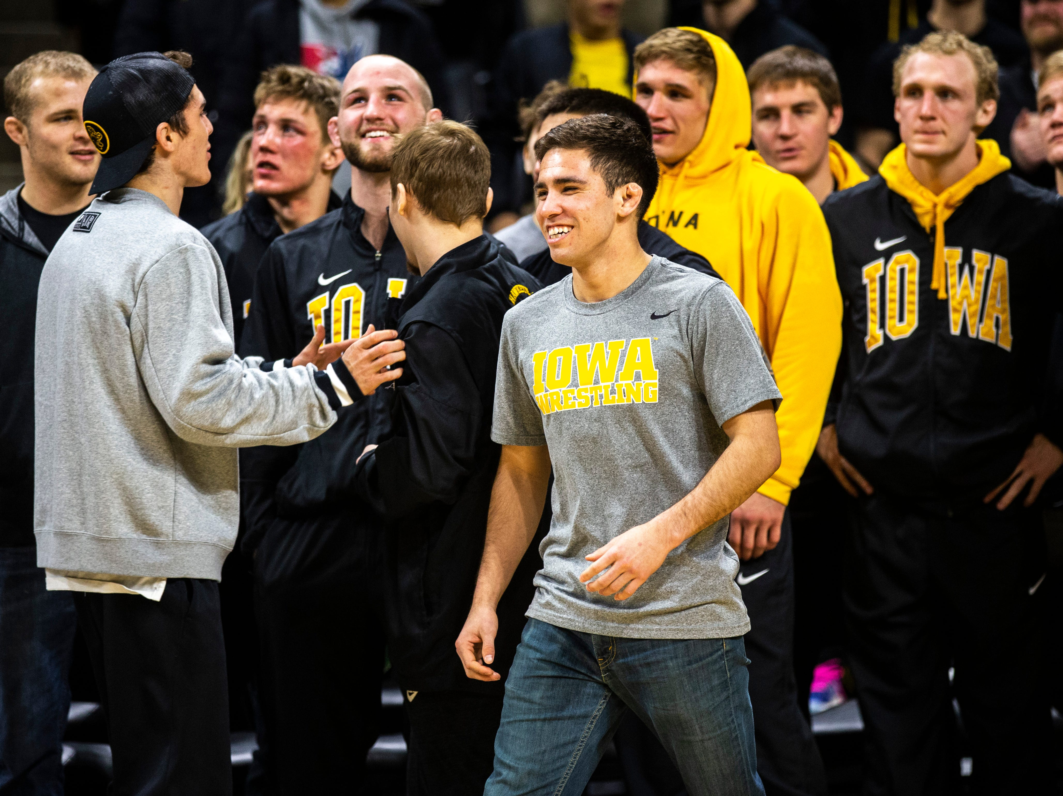 Iowa senior 125-pounder Perez Perez is acknowledged during a NCAA Big Ten Conference wrestling dual on Friday, Feb. 15, 2019 at Carver-Hawkeye Arena in Iowa City, Iowa.