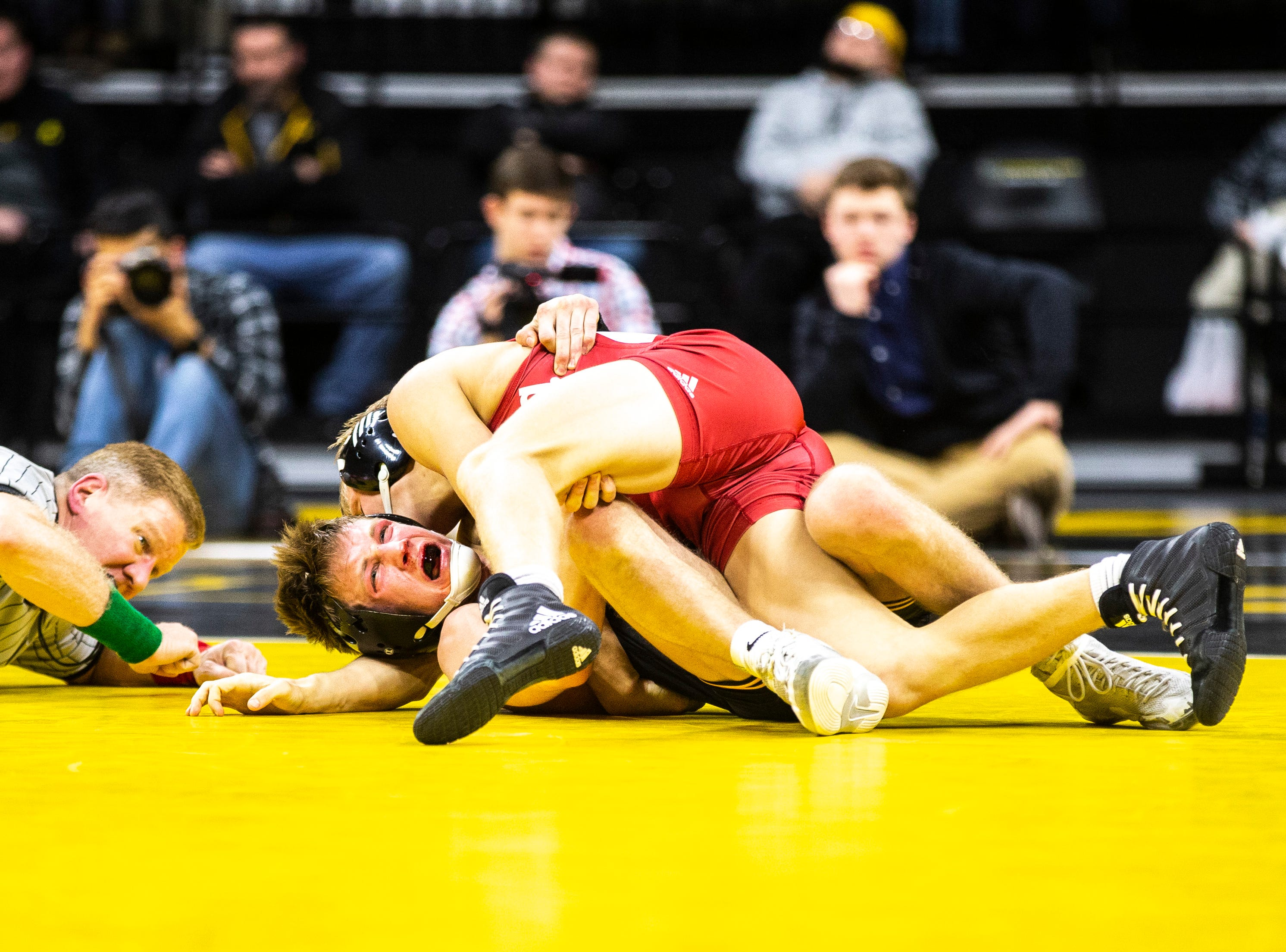 Indiana's Kyle Luigs pins Iowa's Max Murin at 141 during a NCAA Big Ten Conference wrestling dual on Friday, Feb. 15, 2019 at Carver-Hawkeye Arena in Iowa City, Iowa.