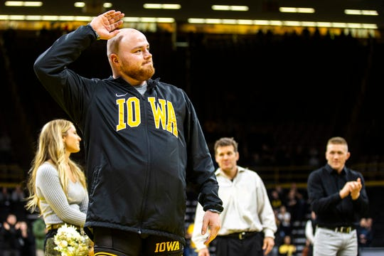 Iowa senior 285-pound Sam Stoll waves to fans during a NCAA Big Ten Conference wrestling dual on Friday, Feb. 15, 2019 at Carver-Hawkeye Arena in Iowa City, Iowa.