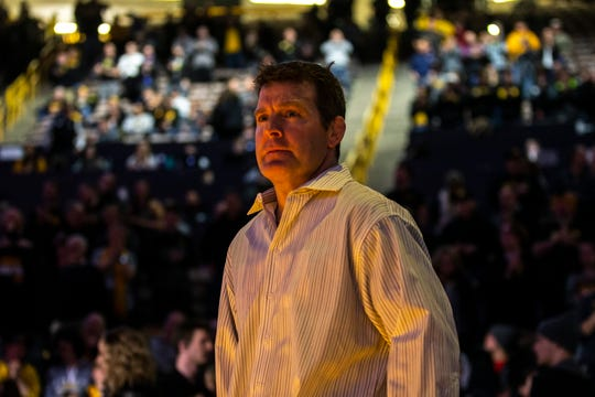 Iowa head coach Tom Brands walks out to the mat during a NCAA Big Ten Conference wrestling dual on Friday, Feb. 15, 2019 at Carver-Hawkeye Arena in Iowa City, Iowa.