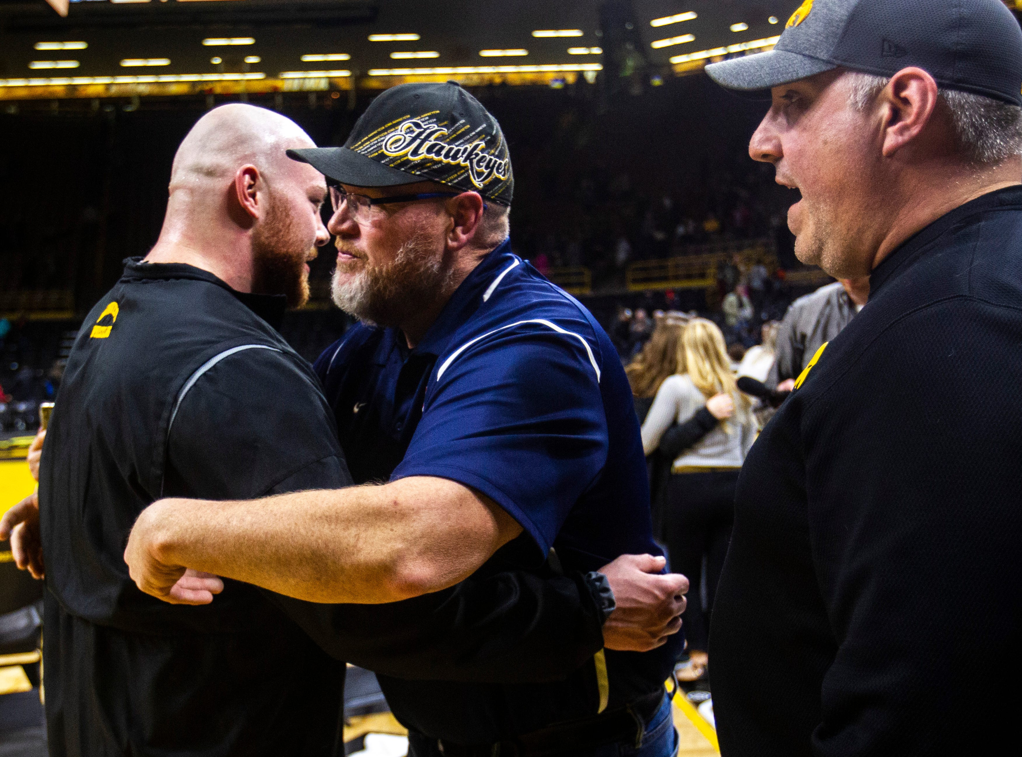 Iowa senior 285-pounder Sam Stoll gets a hug from family members after a NCAA Big Ten Conference wrestling dual on Friday, Feb. 15, 2019 at Carver-Hawkeye Arena in Iowa City, Iowa.