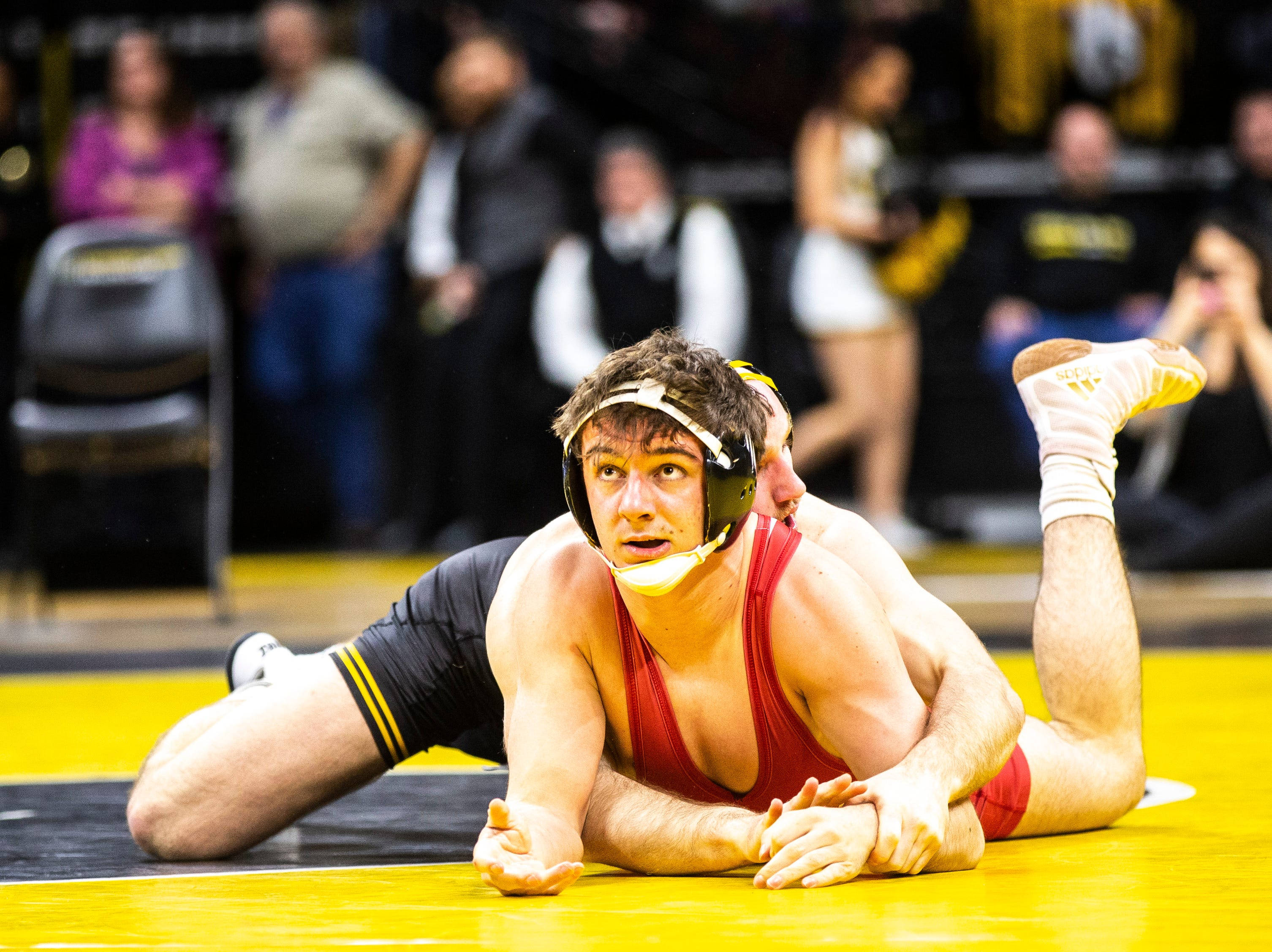 Iowa's Alex Marinelli, back, wrestles Indiana's Dillon Hoey at 165 during a NCAA Big Ten Conference wrestling dual on Friday, Feb. 15, 2019 at Carver-Hawkeye Arena in Iowa City, Iowa.