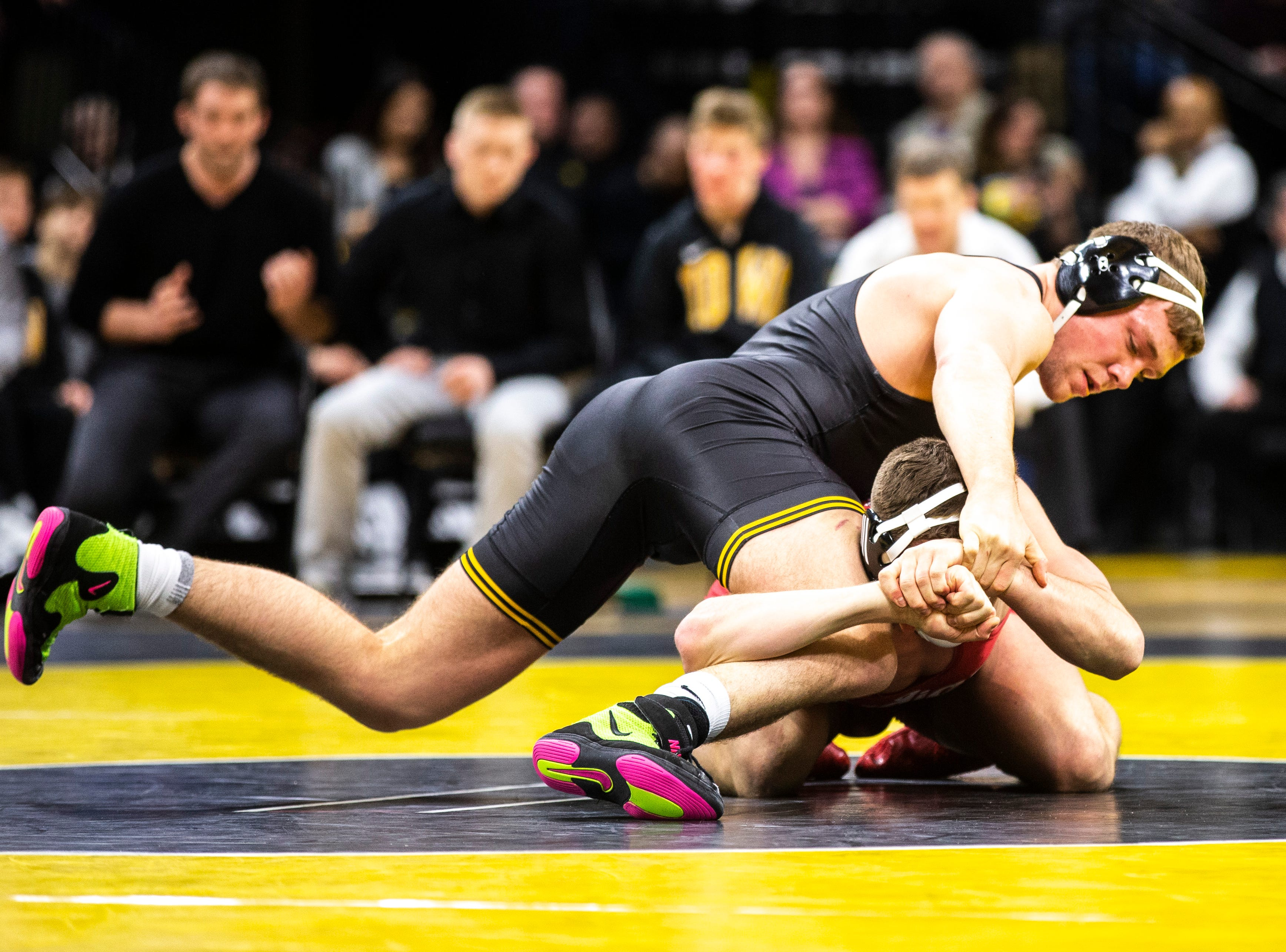 Iowa's Jacob Warner, left, wrestles Indiana's Jake Kleimola at 197 during a NCAA Big Ten Conference wrestling dual on Friday, Feb. 15, 2019 at Carver-Hawkeye Arena in Iowa City, Iowa.