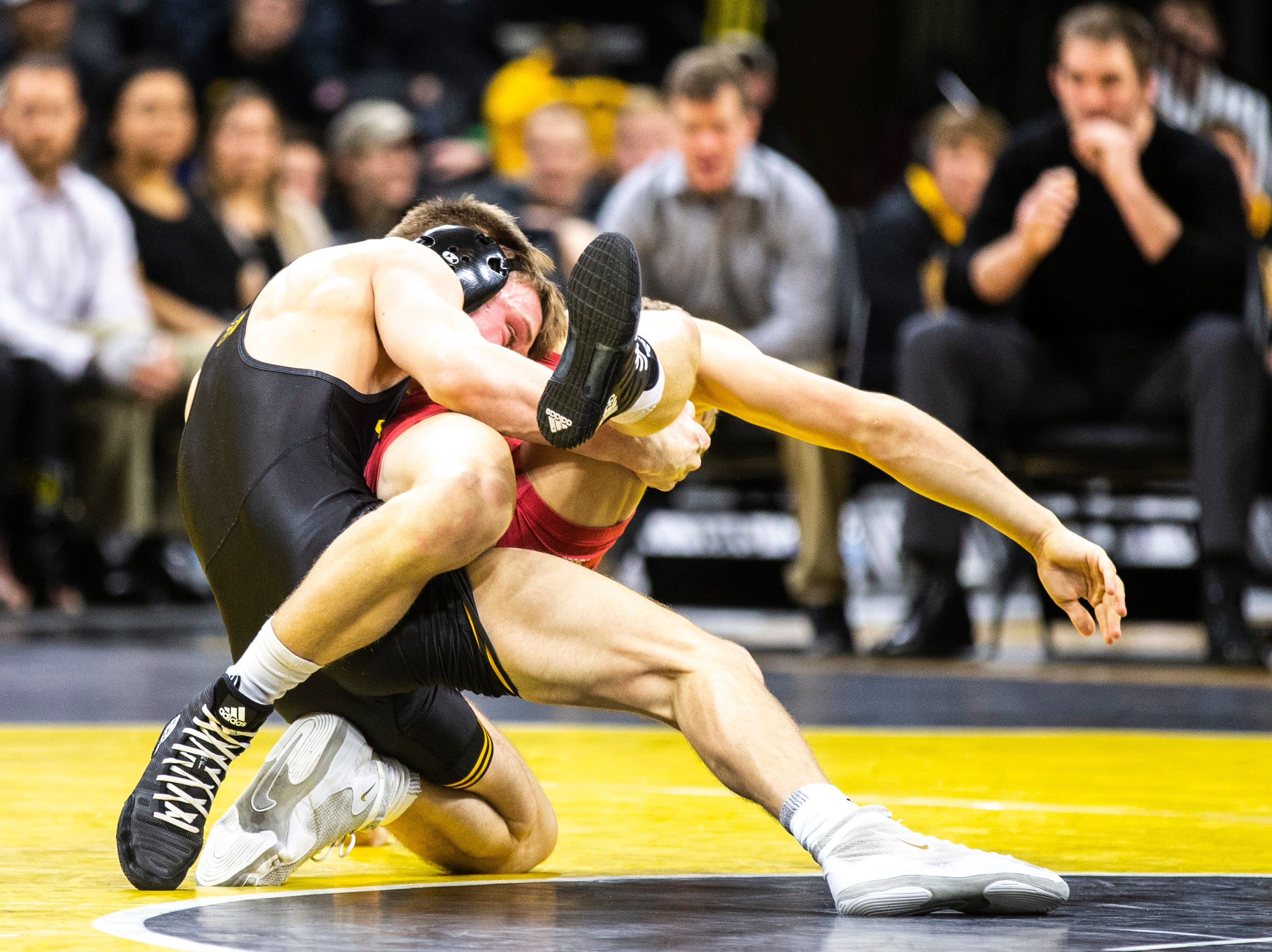 Iowa's Max Murin, left, wrestles Indiana's Kyle Luigs at 141 during a NCAA Big Ten Conference wrestling dual on Friday, Feb. 15, 2019 at Carver-Hawkeye Arena in Iowa City, Iowa.