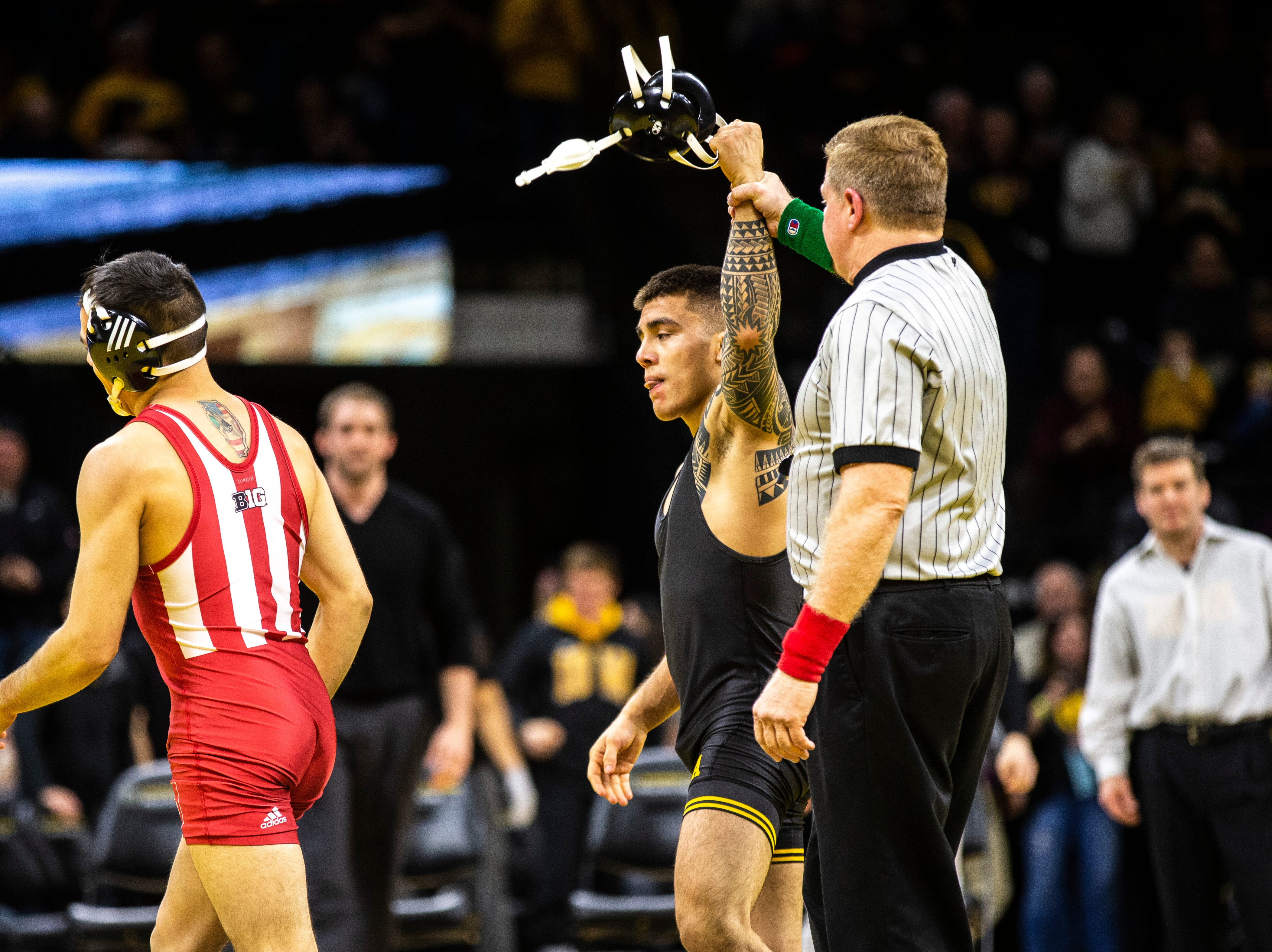 Iowa's Pat Lugo has his hand raised after pinning Indiana's Fernie Luigs at 149 during a NCAA Big Ten Conference wrestling dual on Friday, Feb. 15, 2019 at Carver-Hawkeye Arena in Iowa City, Iowa.