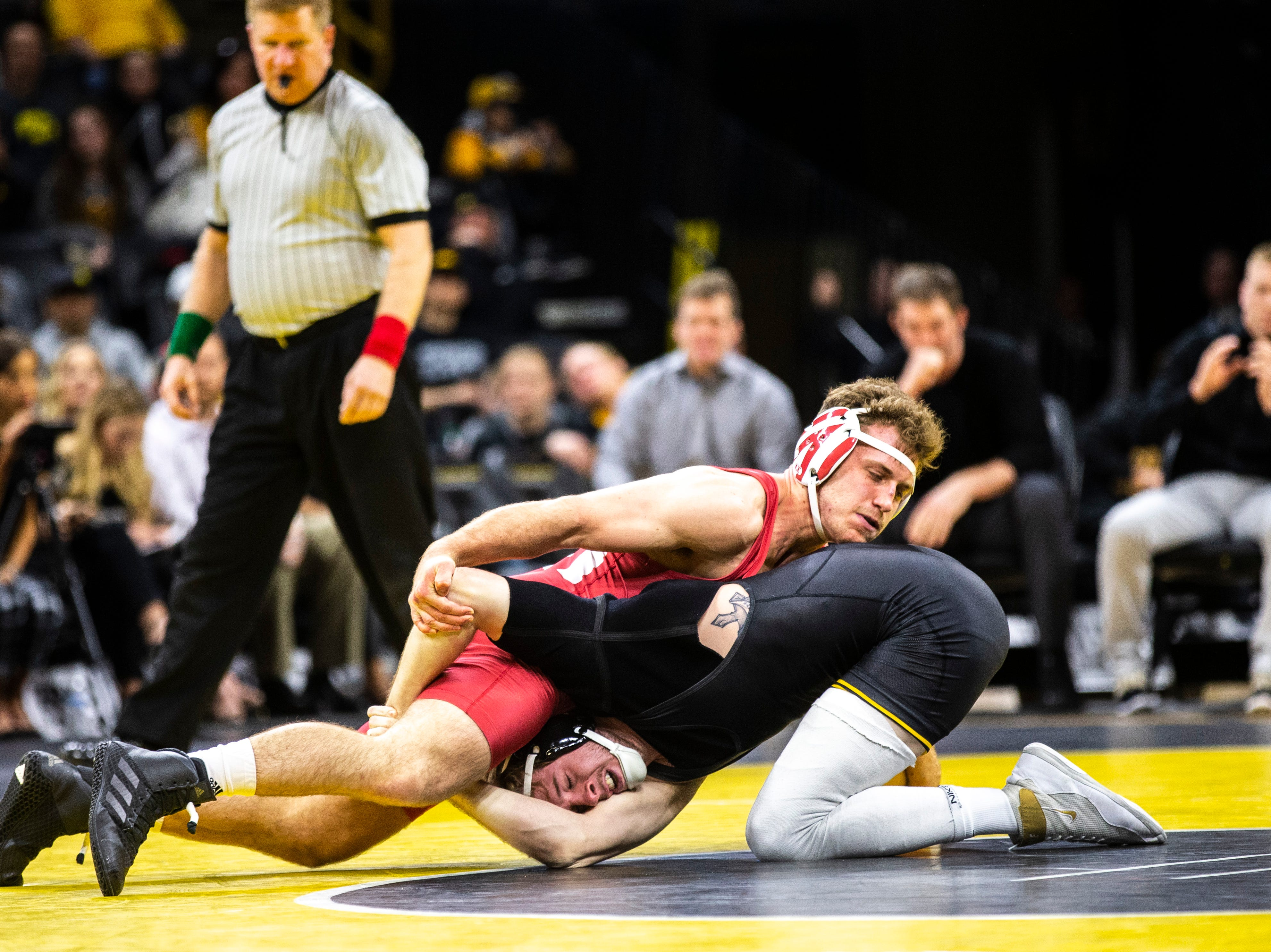 Indiana's Jacob Cavaciu, left, wrestles Iowa's Mitch Bowman at 175 during a NCAA Big Ten Conference wrestling dual on Friday, Feb. 15, 2019 at Carver-Hawkeye Arena in Iowa City, Iowa.