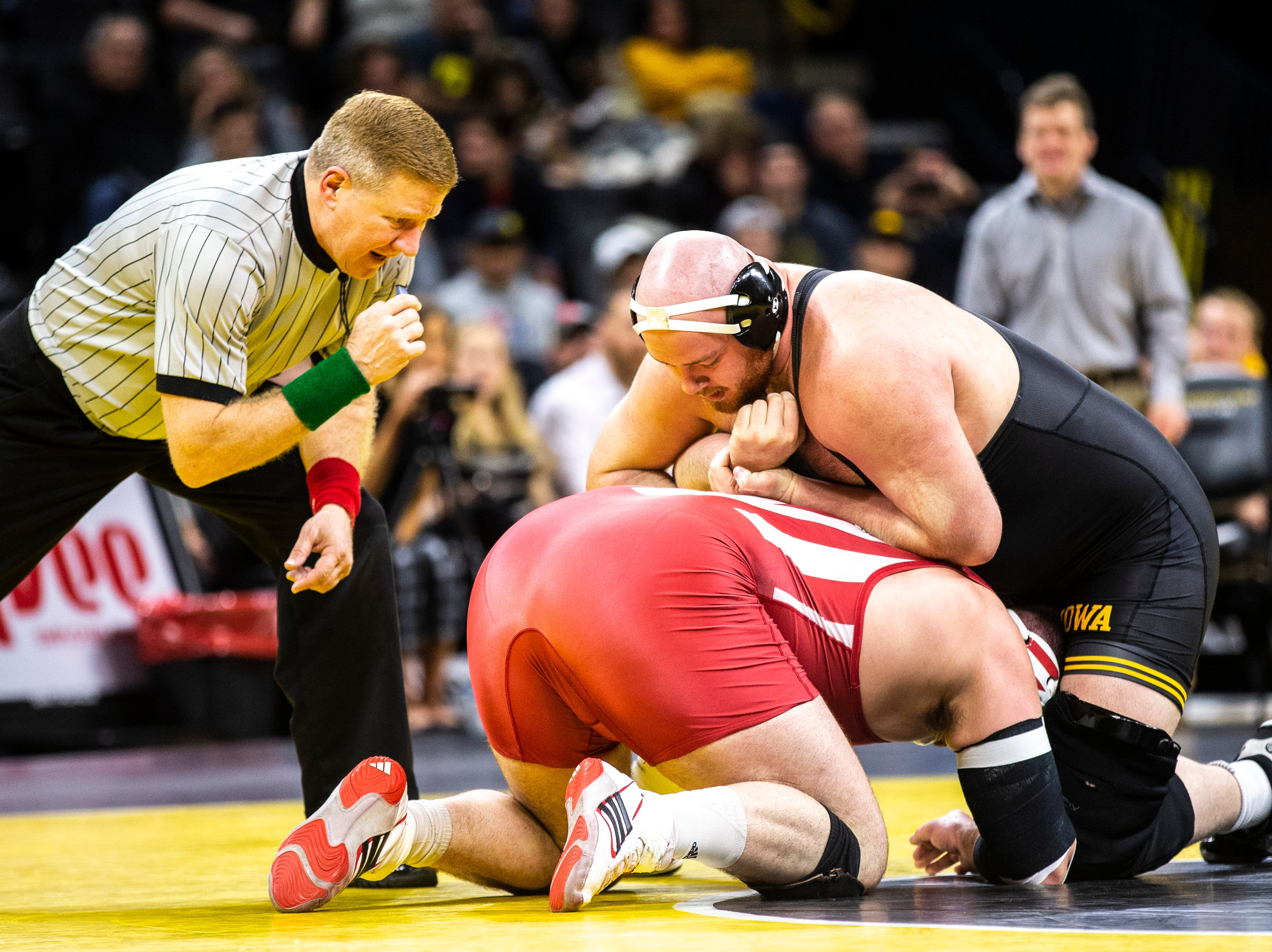 Iowa's Sam Stoll, right, wrestels Indiana's Fletcher Miller at 285 during a NCAA Big Ten Conference wrestling dual on Friday, Feb. 15, 2019 at Carver-Hawkeye Arena in Iowa City, Iowa.