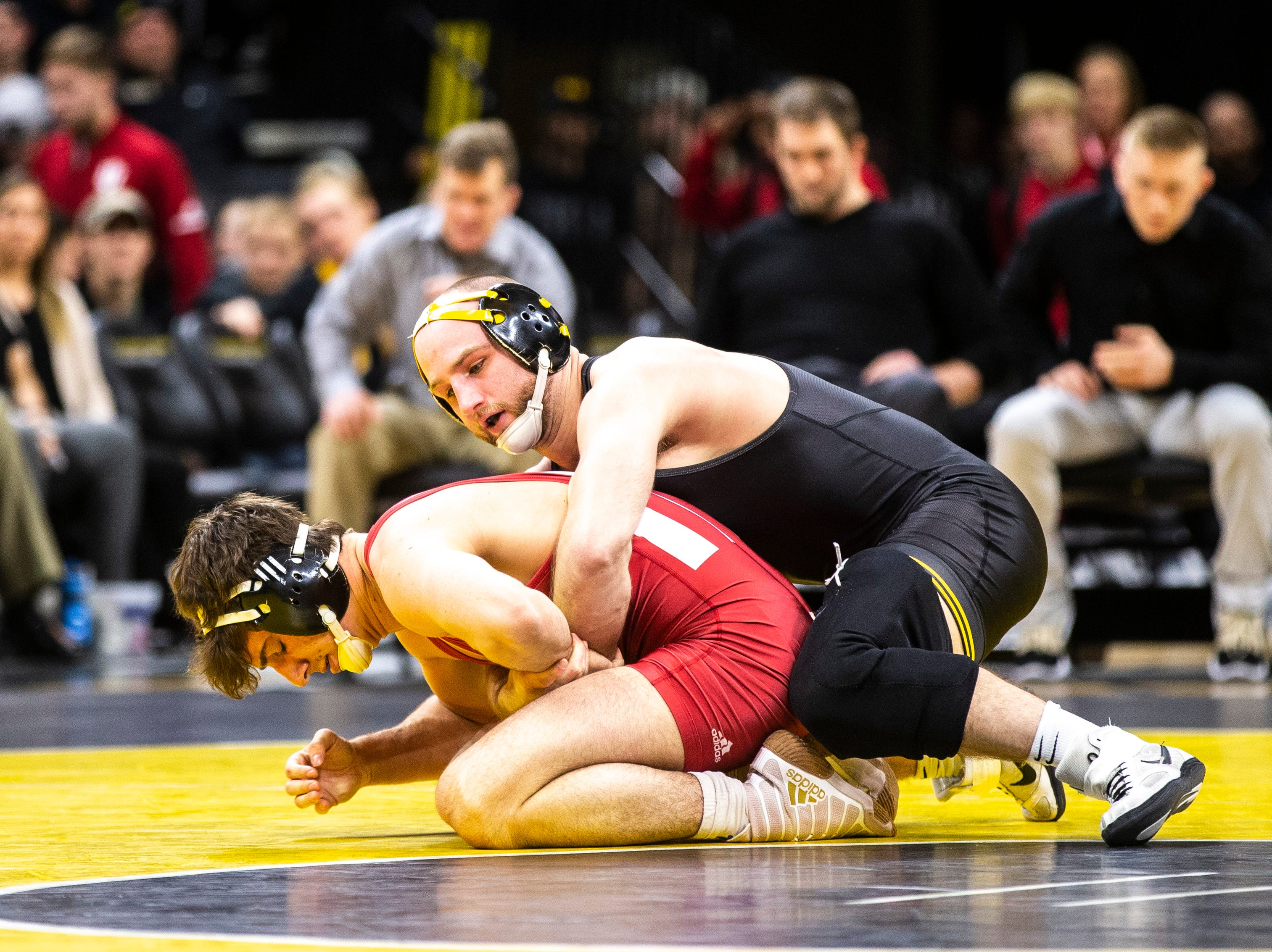 Iowa's Alex Marinelli, right, wrestles Indiana's Dillon Hoey at 165 during a NCAA Big Ten Conference wrestling dual on Friday, Feb. 15, 2019 at Carver-Hawkeye Arena in Iowa City, Iowa.