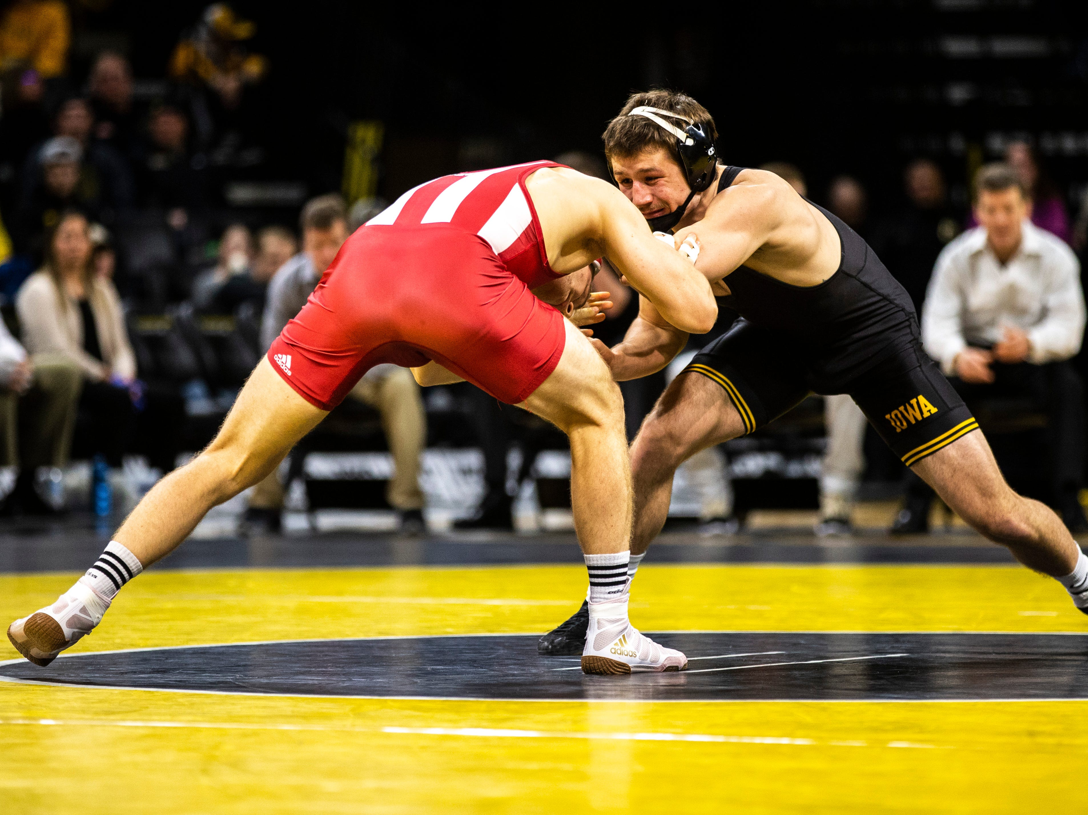 Iowa's Jeren Glosser, right, wrestles Indiana's Jake Danishek at 157 during a NCAA Big Ten Conference wrestling dual on Friday, Feb. 15, 2019 at Carver-Hawkeye Arena in Iowa City, Iowa.