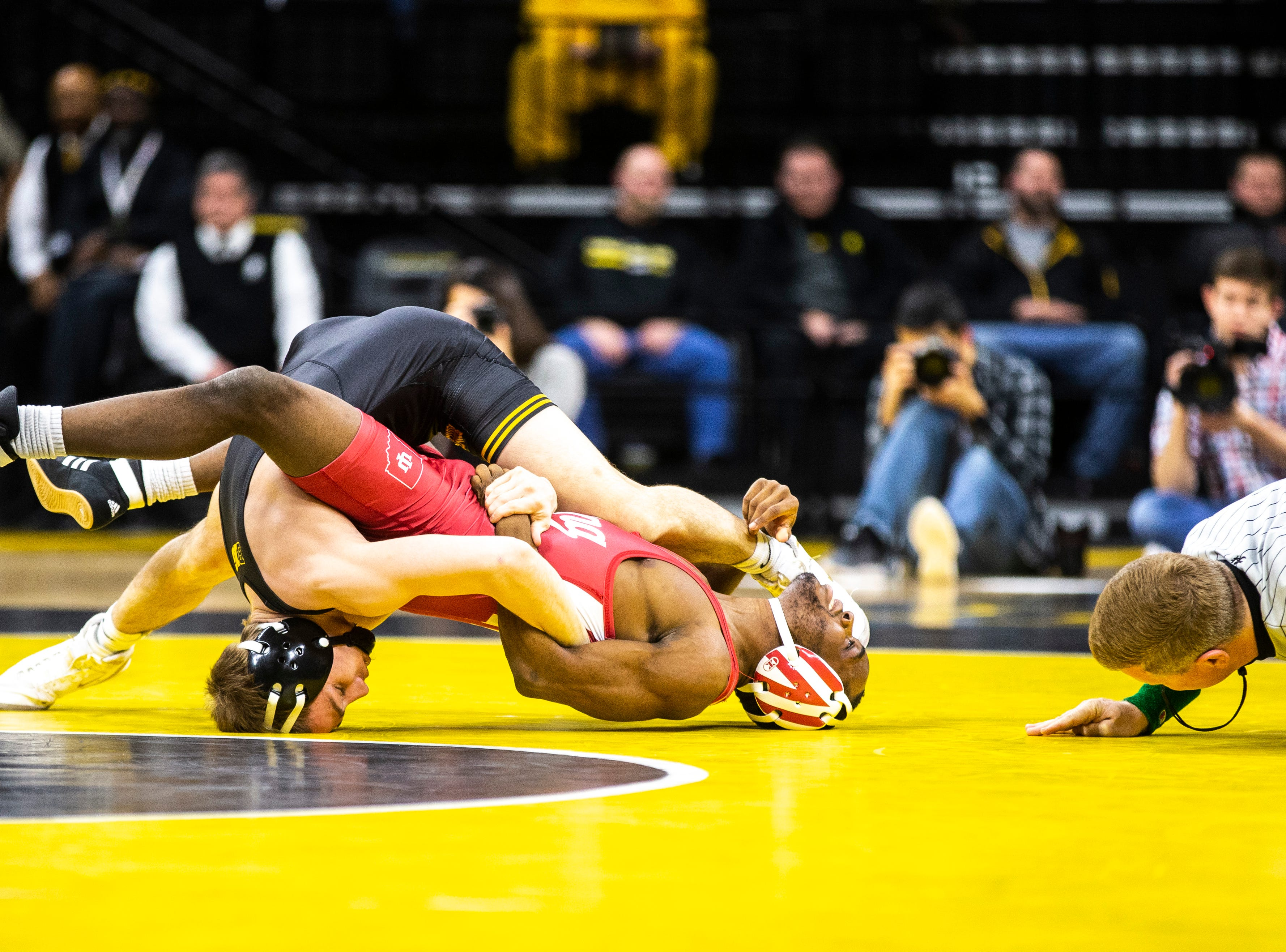 Iowa's Spencer Lee, left, gets a near fall while wrestling Indiana's Elijah Oliver at 125 during a NCAA Big Ten Conference wrestling dual on Friday, Feb. 15, 2019 at Carver-Hawkeye Arena in Iowa City, Iowa.