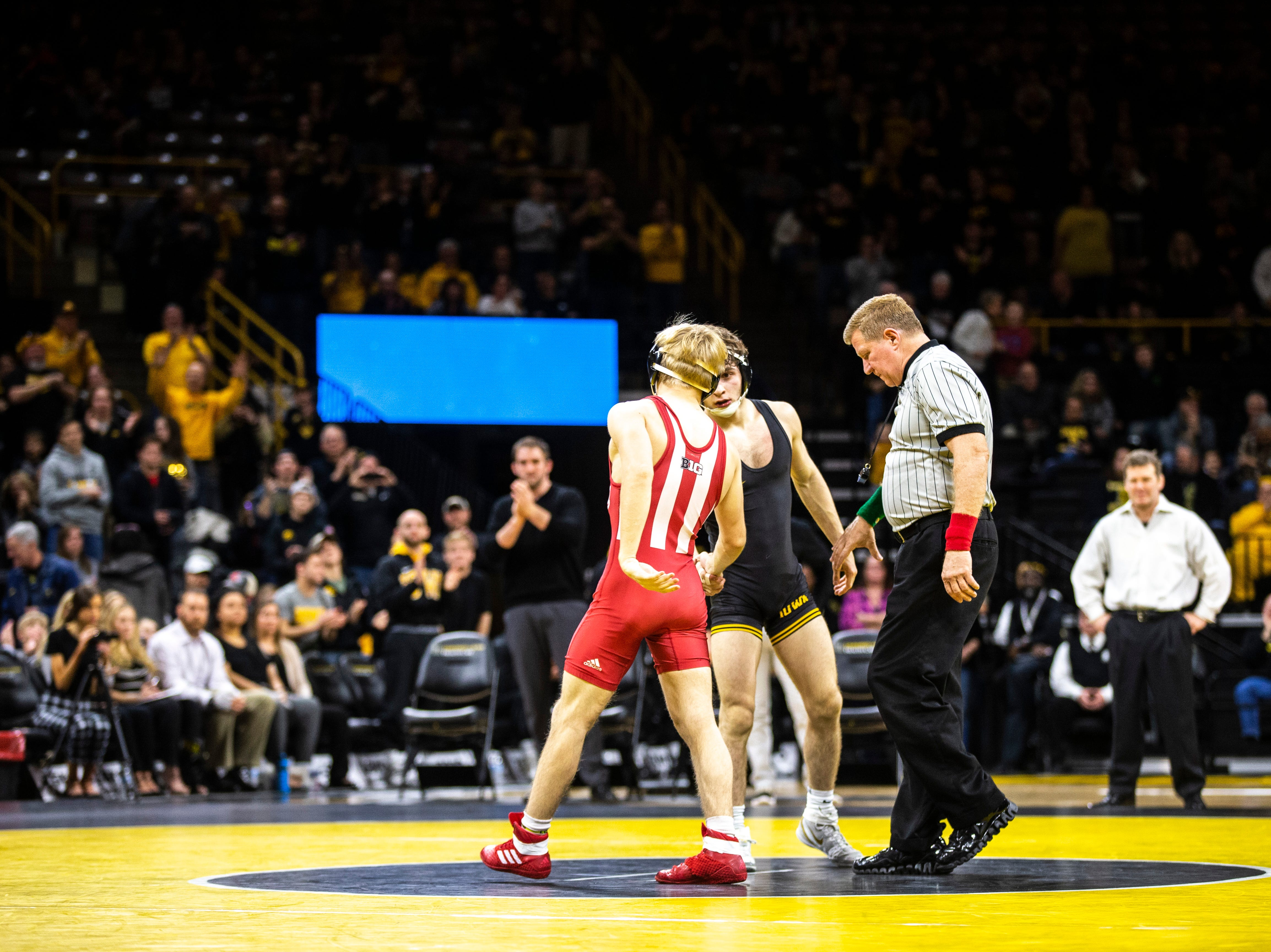 Iowa's Austin DeSanto shakes hands with Indiana's Paul Konrath at 133 during a NCAA Big Ten Conference wrestling dual on Friday, Feb. 15, 2019 at Carver-Hawkeye Arena in Iowa City, Iowa.