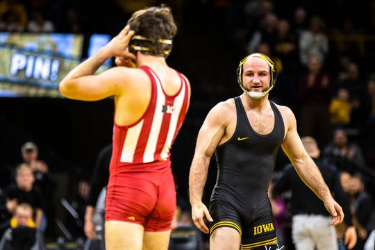 Iowa's Alex Marinelli reacts after pinning Indiana's Dillon Hoey at 165 during a NCAA Big Ten Conference wrestling dual on Friday, Feb. 15, 2019, at Carver-Hawkeye Arena in Iowa City, Iowa.