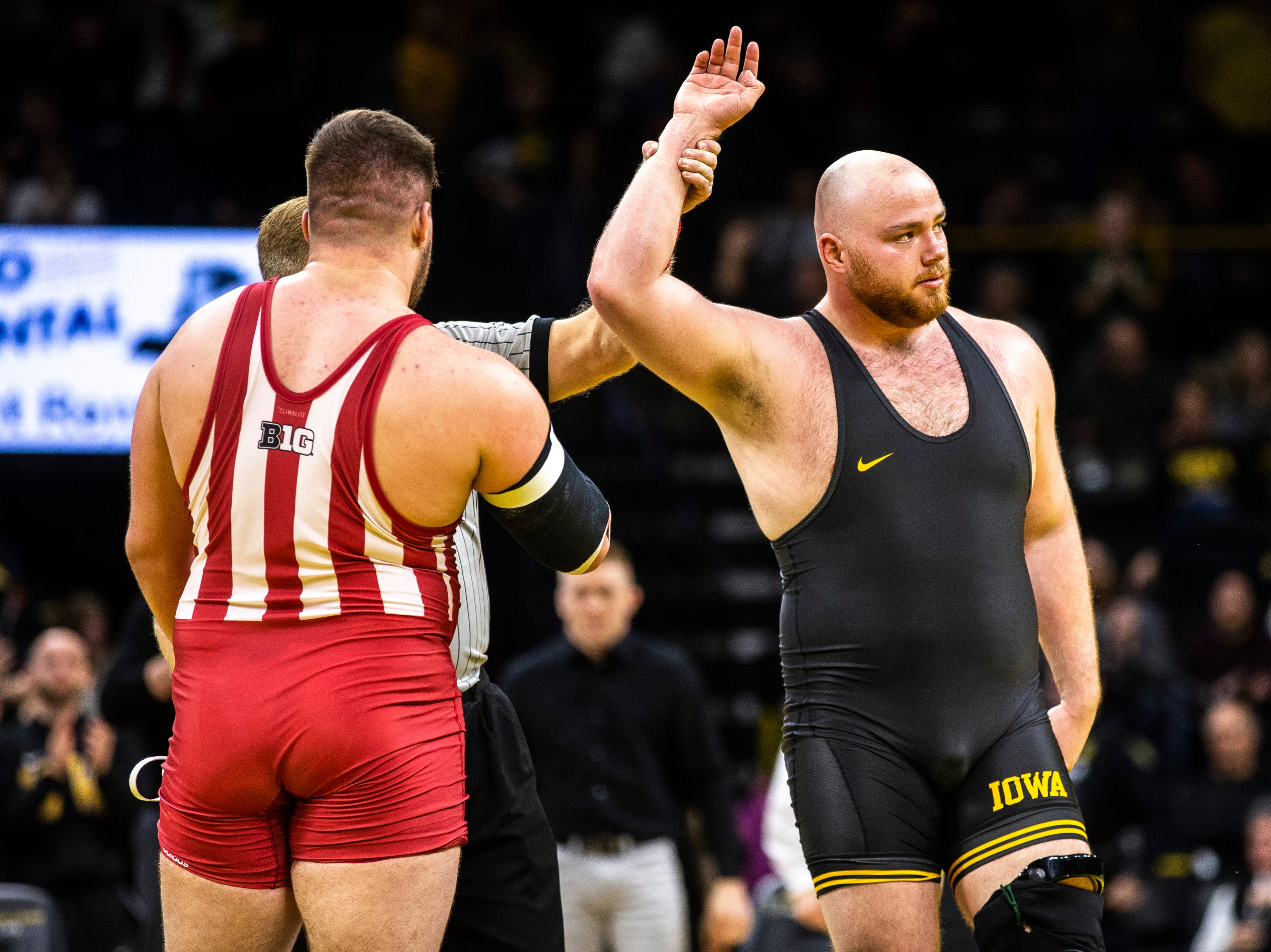 Iowa's Sam Stoll, right, has his hand raised after scoring a major decision over Indiana's Fletcher Miller at 285 during a NCAA Big Ten Conference wrestling dual on Friday, Feb. 15, 2019 at Carver-Hawkeye Arena in Iowa City, Iowa.