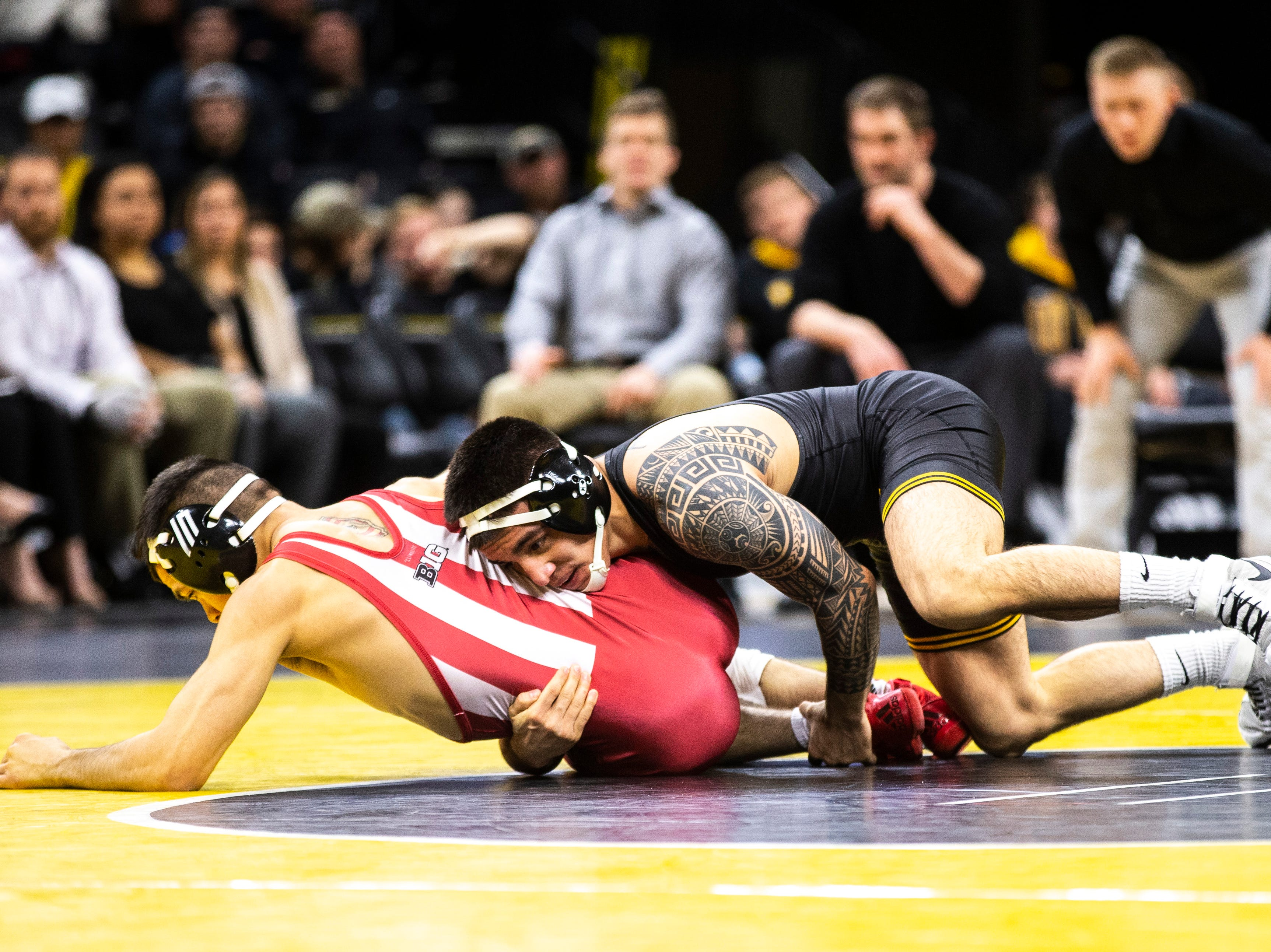 Iowa's Pat Lugo, right, wrestles Indiana's Fernie Luigs at 149 during a NCAA Big Ten Conference wrestling dual on Friday, Feb. 15, 2019 at Carver-Hawkeye Arena in Iowa City, Iowa.