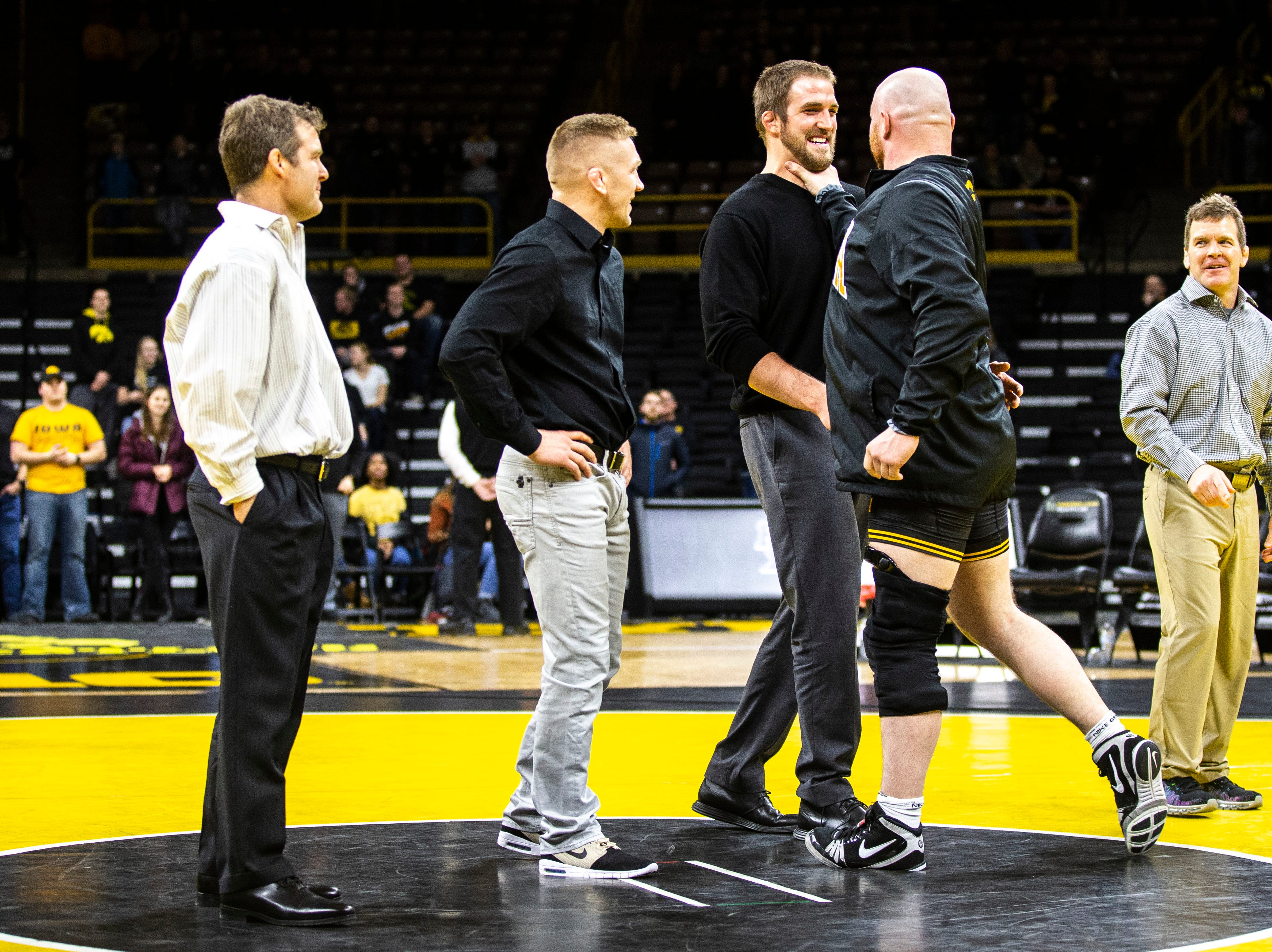 Iowa senior 285-pound Sam Stoll jokes around with assistant Bobby Telford during a NCAA Big Ten Conference wrestling dual on Friday, Feb. 15, 2019 at Carver-Hawkeye Arena in Iowa City, Iowa.