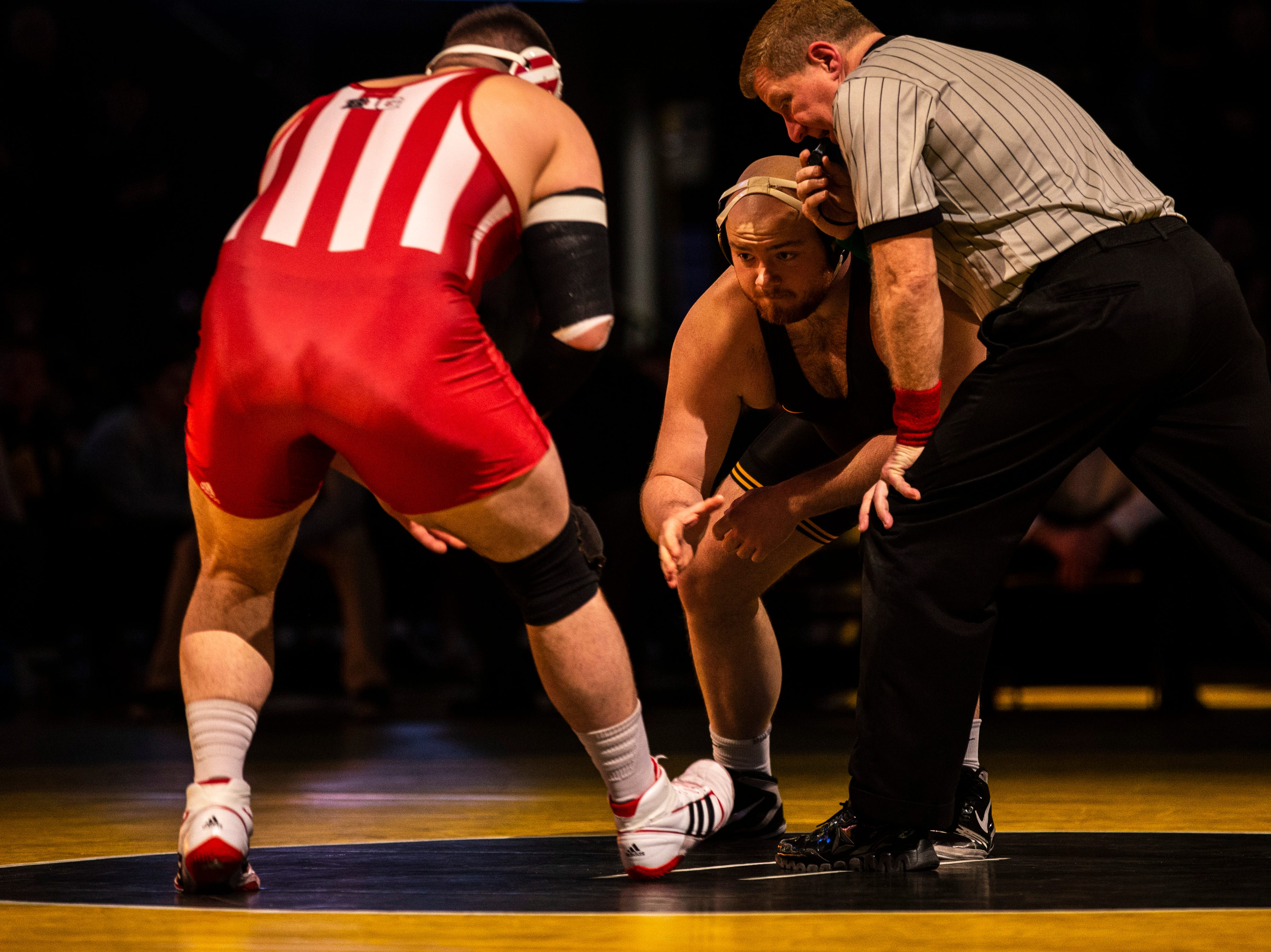 Iowa's Sam Stoll, right, shakes hands with Indiana's Fletcher Miller at 285 during a NCAA Big Ten Conference wrestling dual on Friday, Feb. 15, 2019 at Carver-Hawkeye Arena in Iowa City, Iowa.