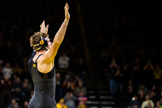 Iowa's Mitch Bowman celebrates after scoring a decision over Indiana's Jacob Cavaciu at 175 during a NCAA Big Ten Conference wrestling dual on Friday, Feb. 15, 2019 at Carver-Hawkeye Arena in Iowa City, Iowa.