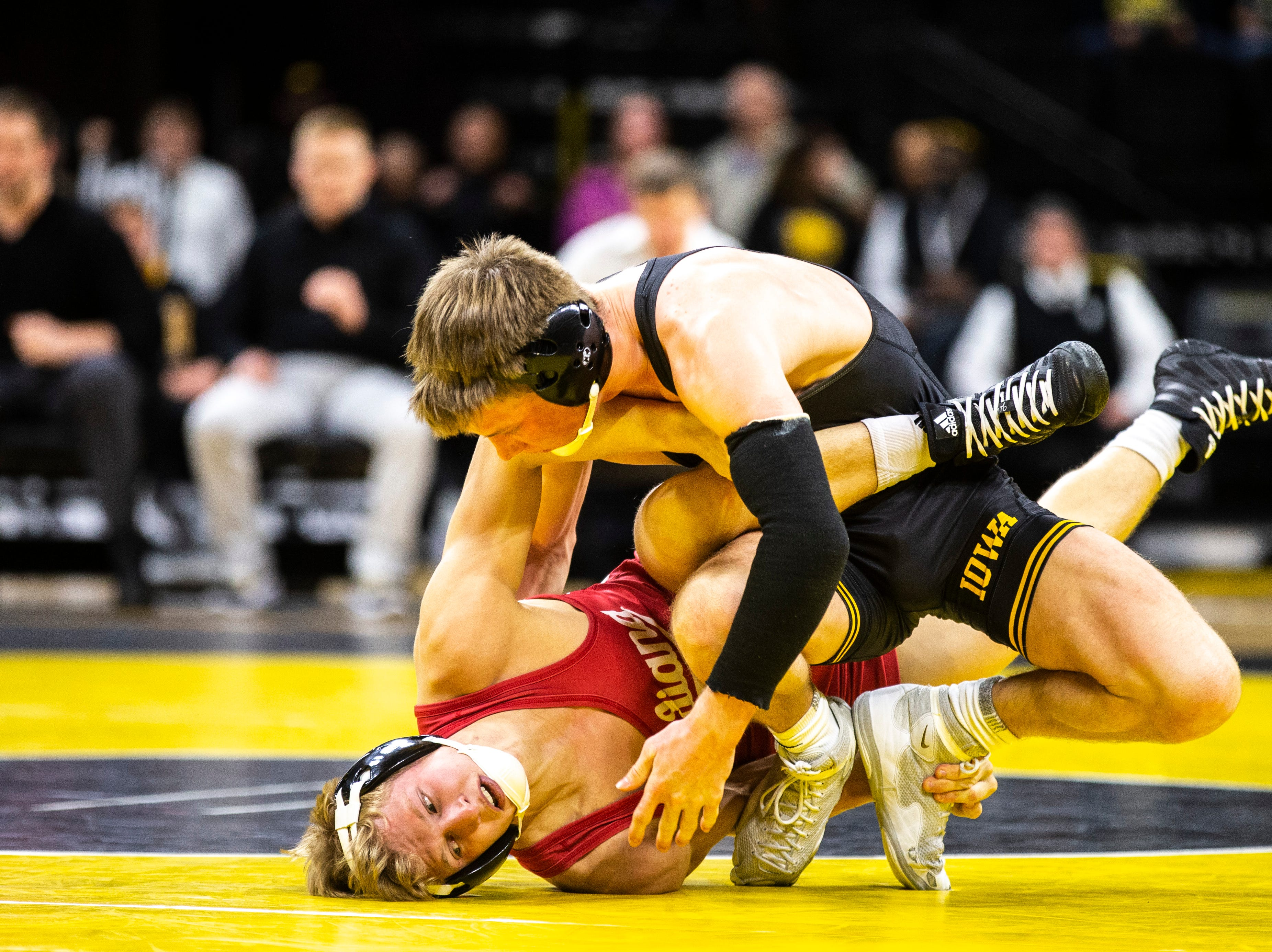 Iowa's Max Murin, right, wrestles Indiana's Kyle Luigs at 141 during a NCAA Big Ten Conference wrestling dual on Friday, Feb. 15, 2019 at Carver-Hawkeye Arena in Iowa City, Iowa.