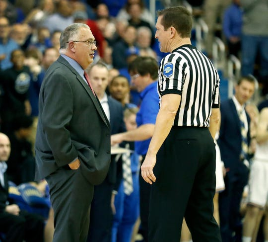 Warren Central Warriors head coach Criss Beyers has a few final words for the office after he was ejected from the game in the third quarter of their IHSAA basketball game at Carmel High School on Friday, Feb 16., 2018. The Greyhounds defeated the Warriors  69-52.