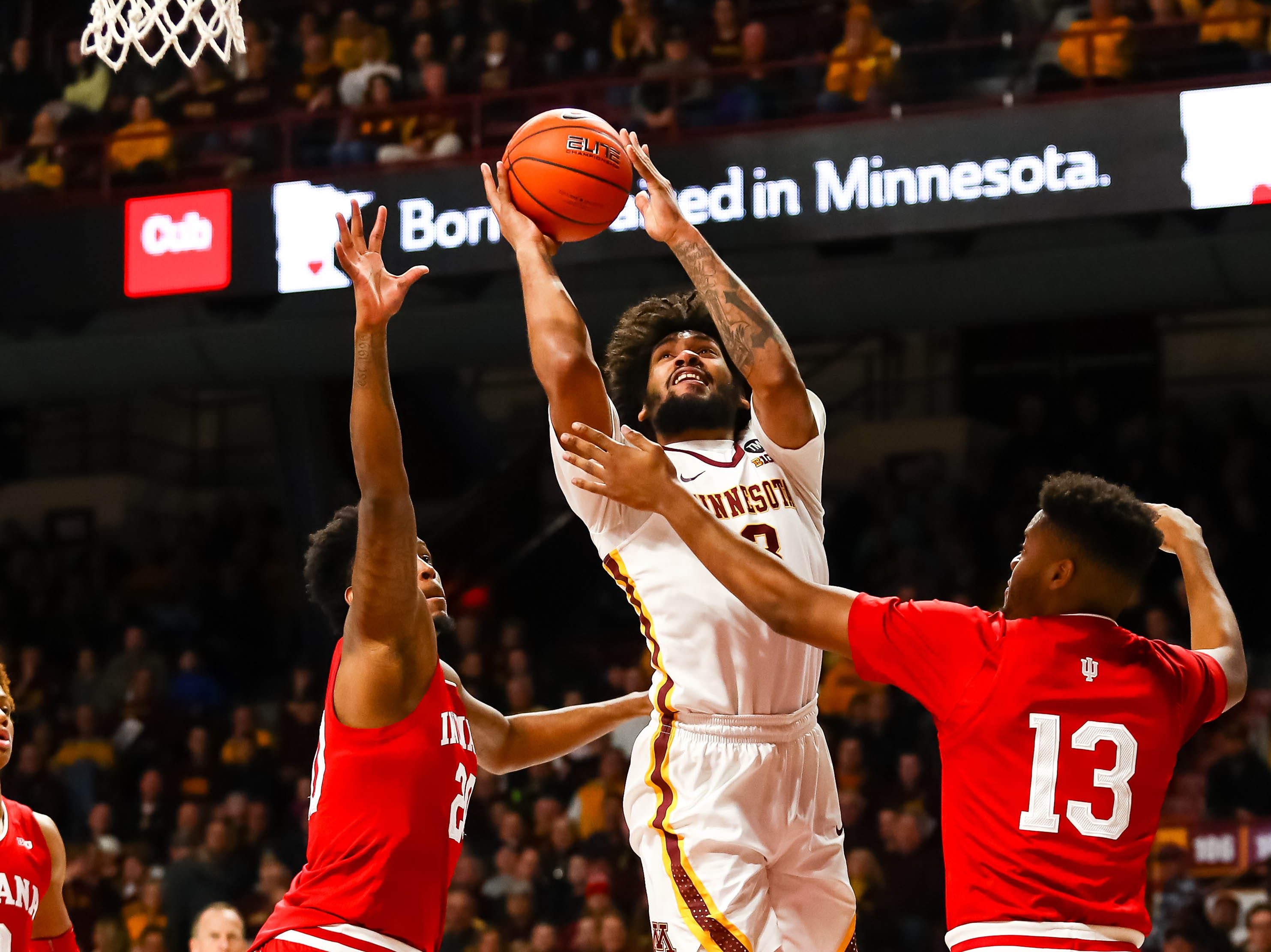 Minnesota Golden Gophers forward Jordan Murphy (3) goes up for a shot while Indiana Hoosiers forward Juwan Morgan (13) defends in the first half at Williams Arena.