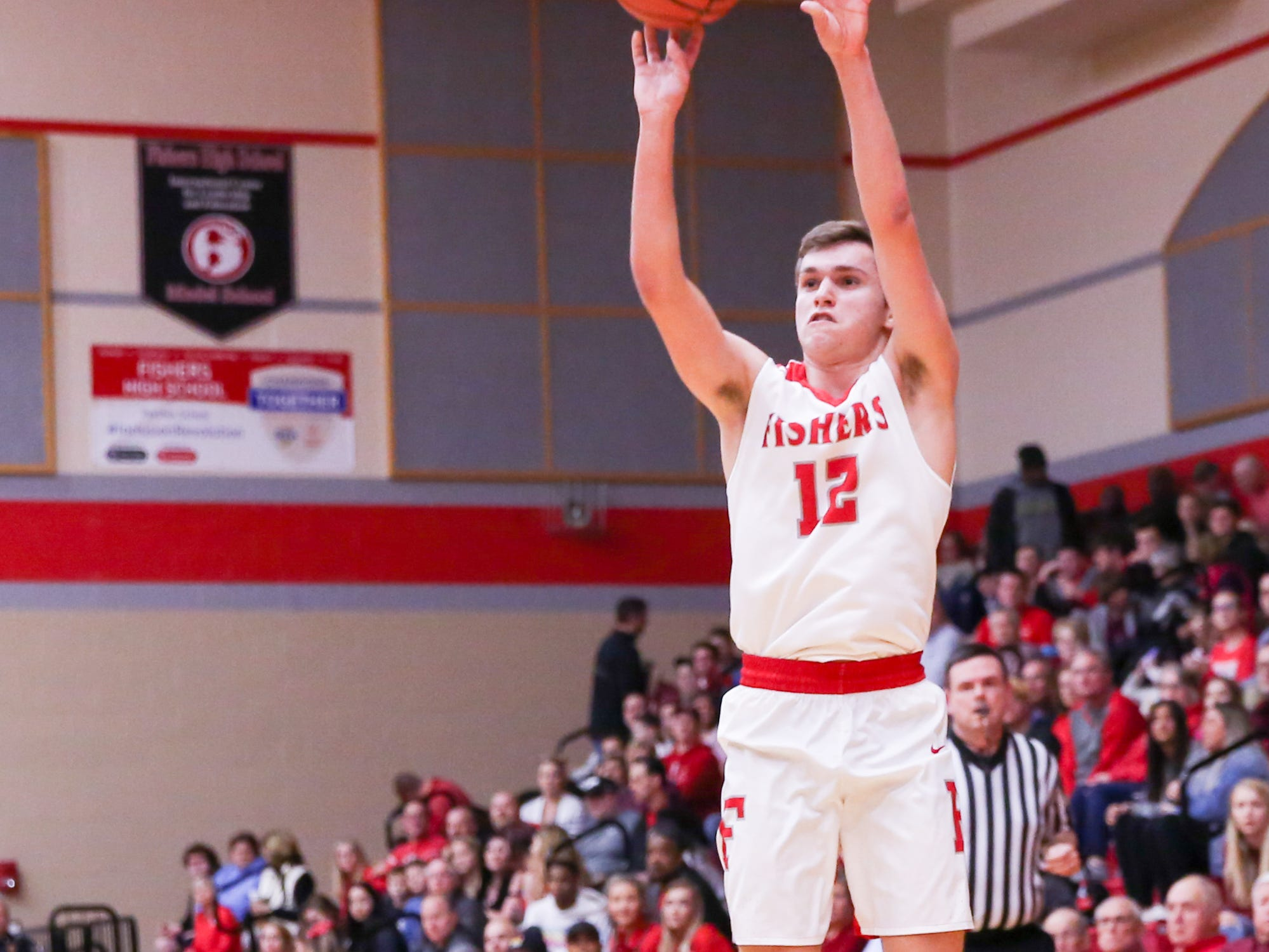 Fisher's Alex Szilagyi (12) with the 3 point attempt during the first half of Zionsville vs. Fishers high school boys varsity basketball game held at Fishers High School, February 15, 2019.